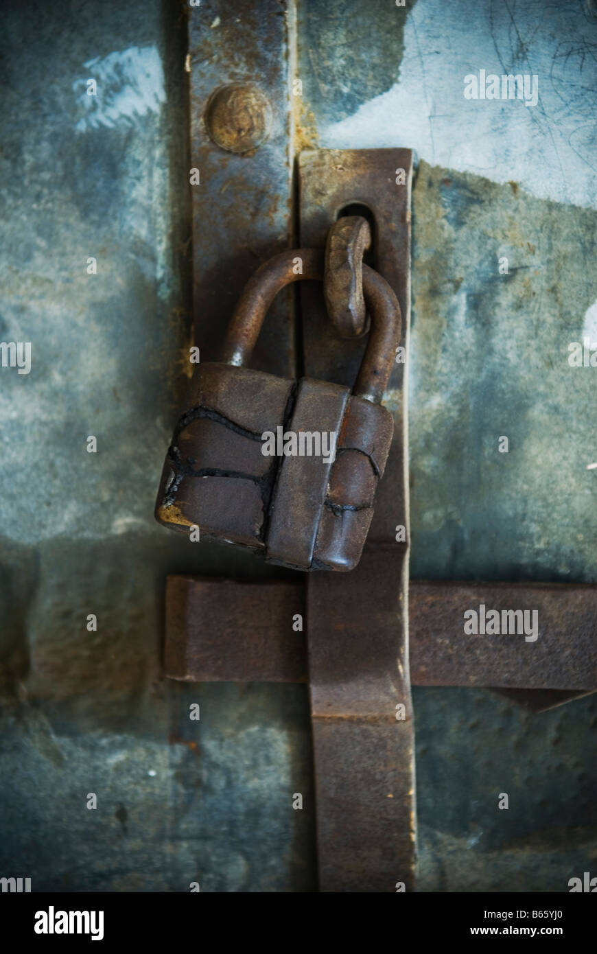 Rusty robust metal lock - Stock Image