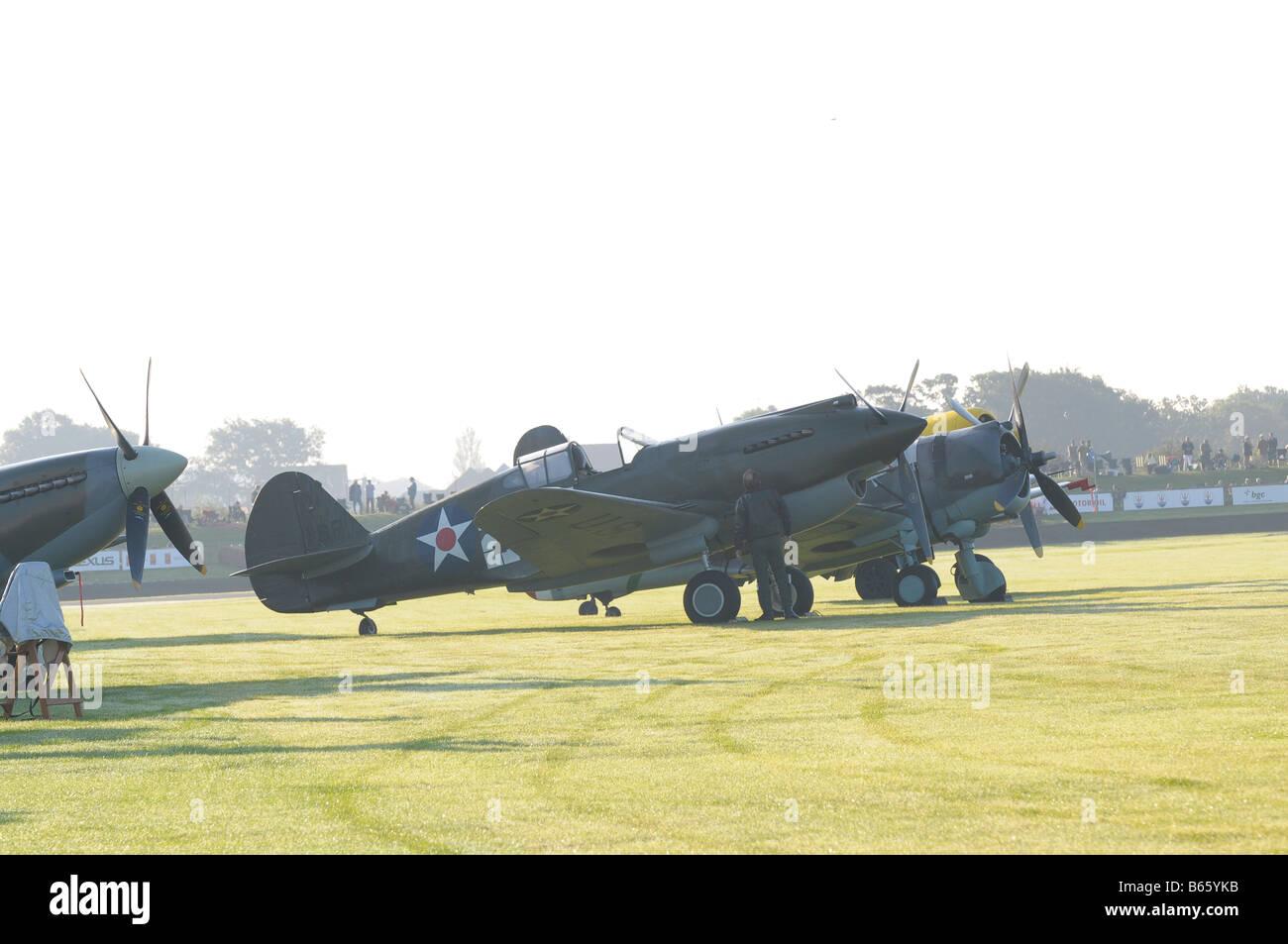 Curtiss P40B Warhawk Kittyhawk 1941 amongst a row of other ww2 planes - Stock Image