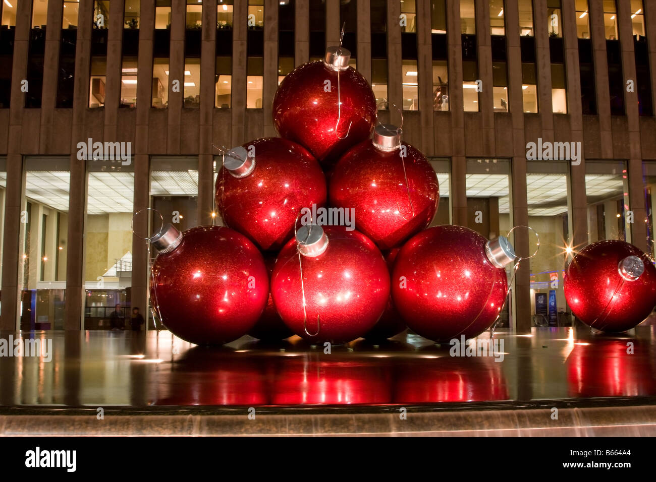 Big red balls as ornaments for the Christmas tree as an art exhibit ...