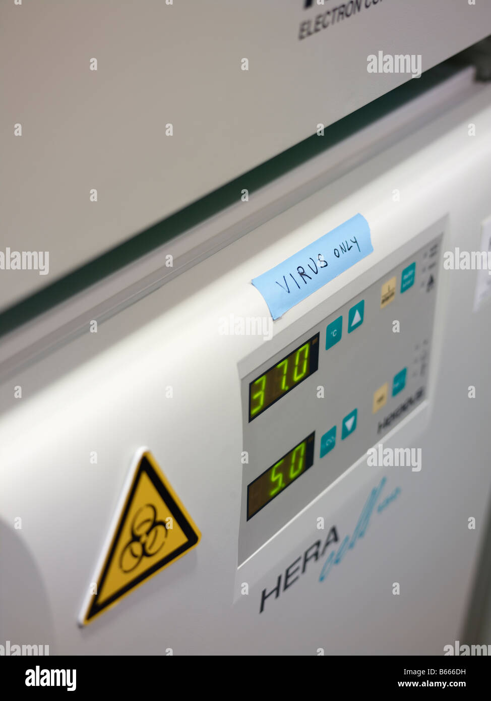 Incubator in a lab with Biohazard and virus only lable - Stock Image