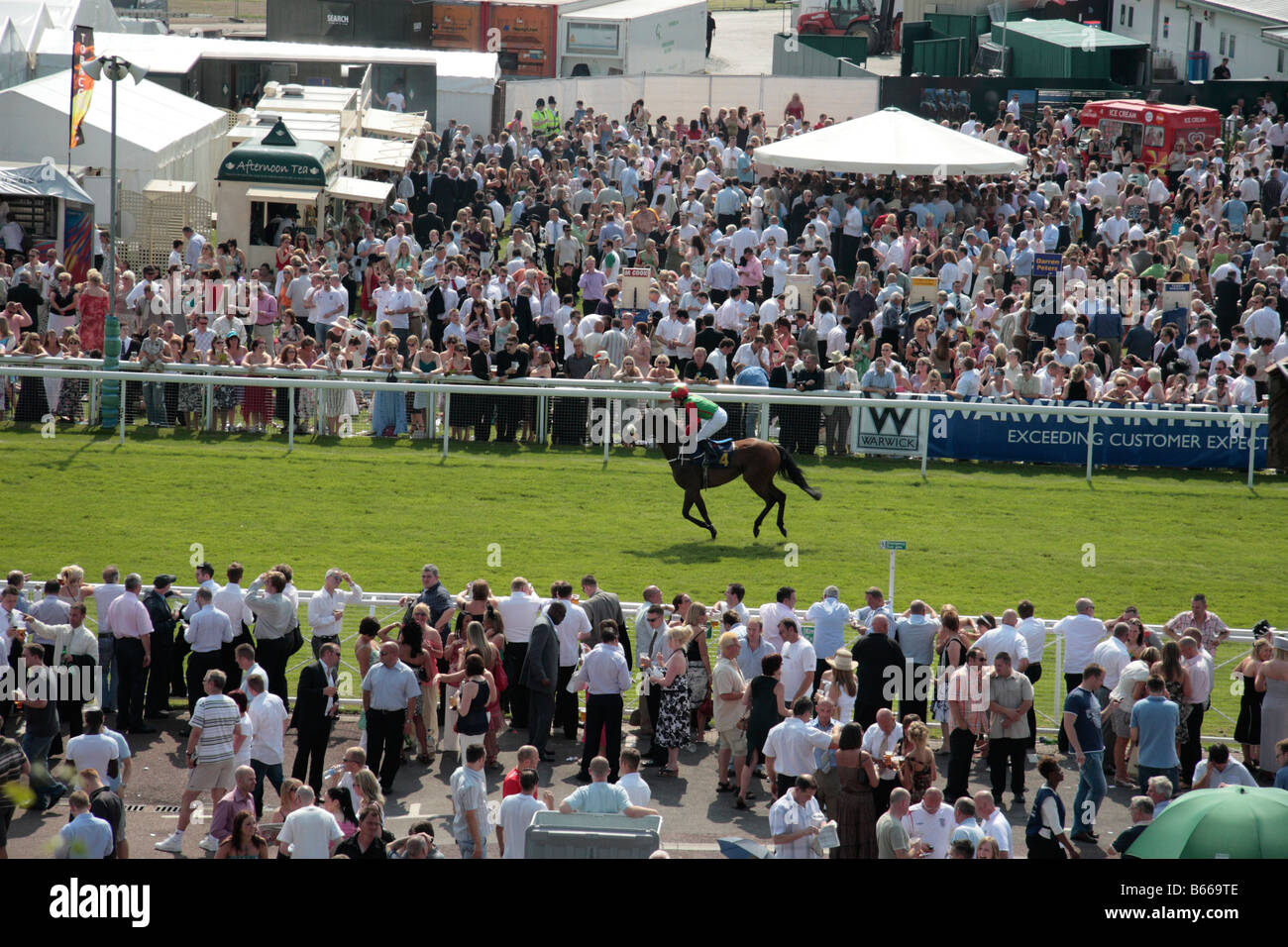 Chester Racecourse Chester 1st July Meeting Showing crowd and horses on course, Cheshire, England - Stock Image