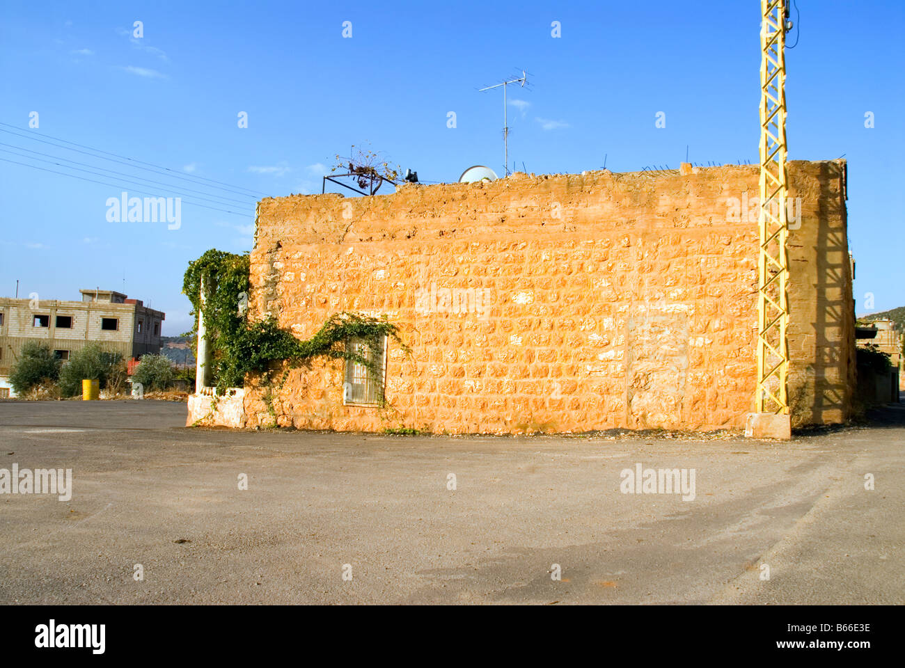 berween past and present house to house yesterday and today lebanon - Stock Image