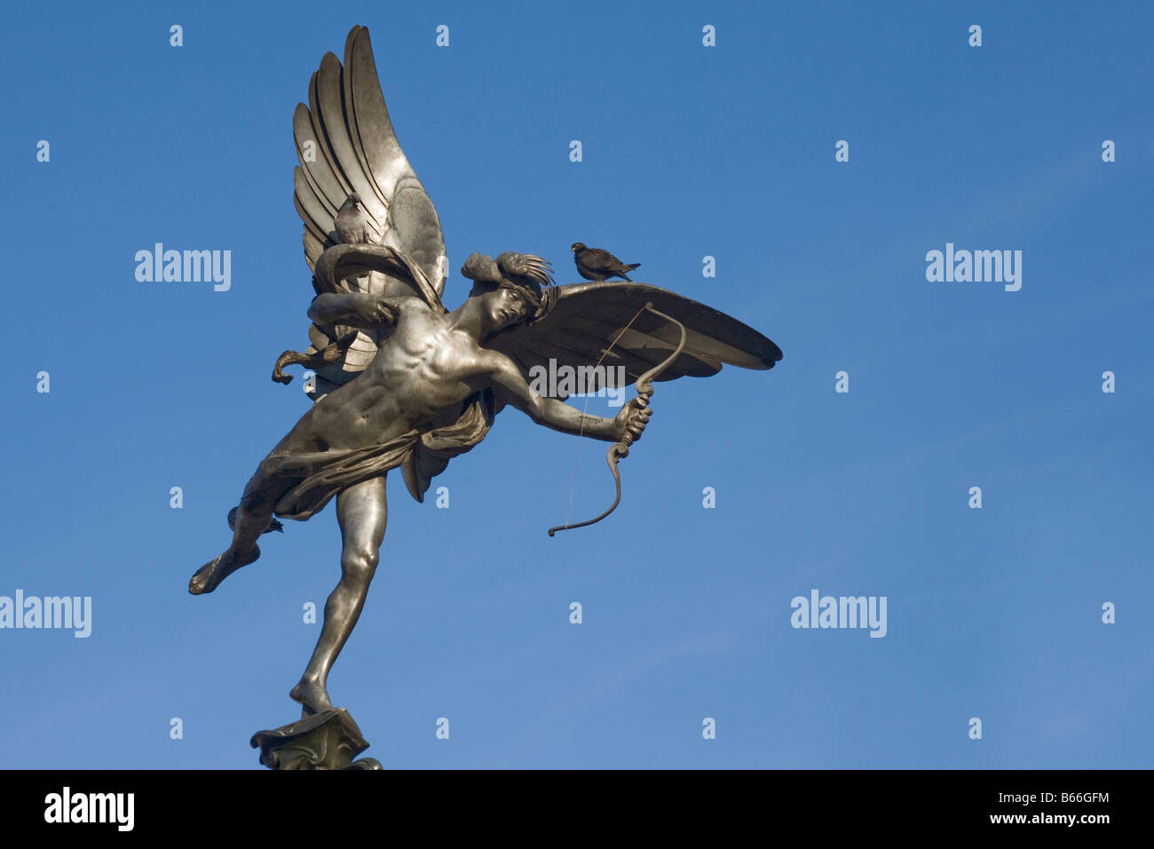 Two pigeons sitting on statue of Eros. Piccadilly Circus, London, England, UK - Stock Image