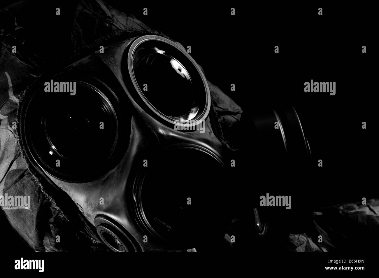 Soldier in respirator and protective suit - Stock Image