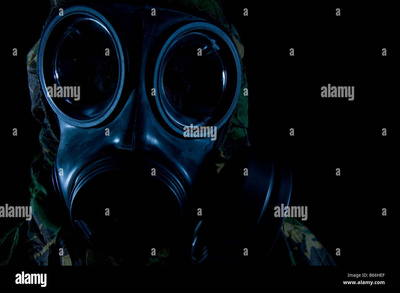 Soldier in respirator and protective suit Stock Photo