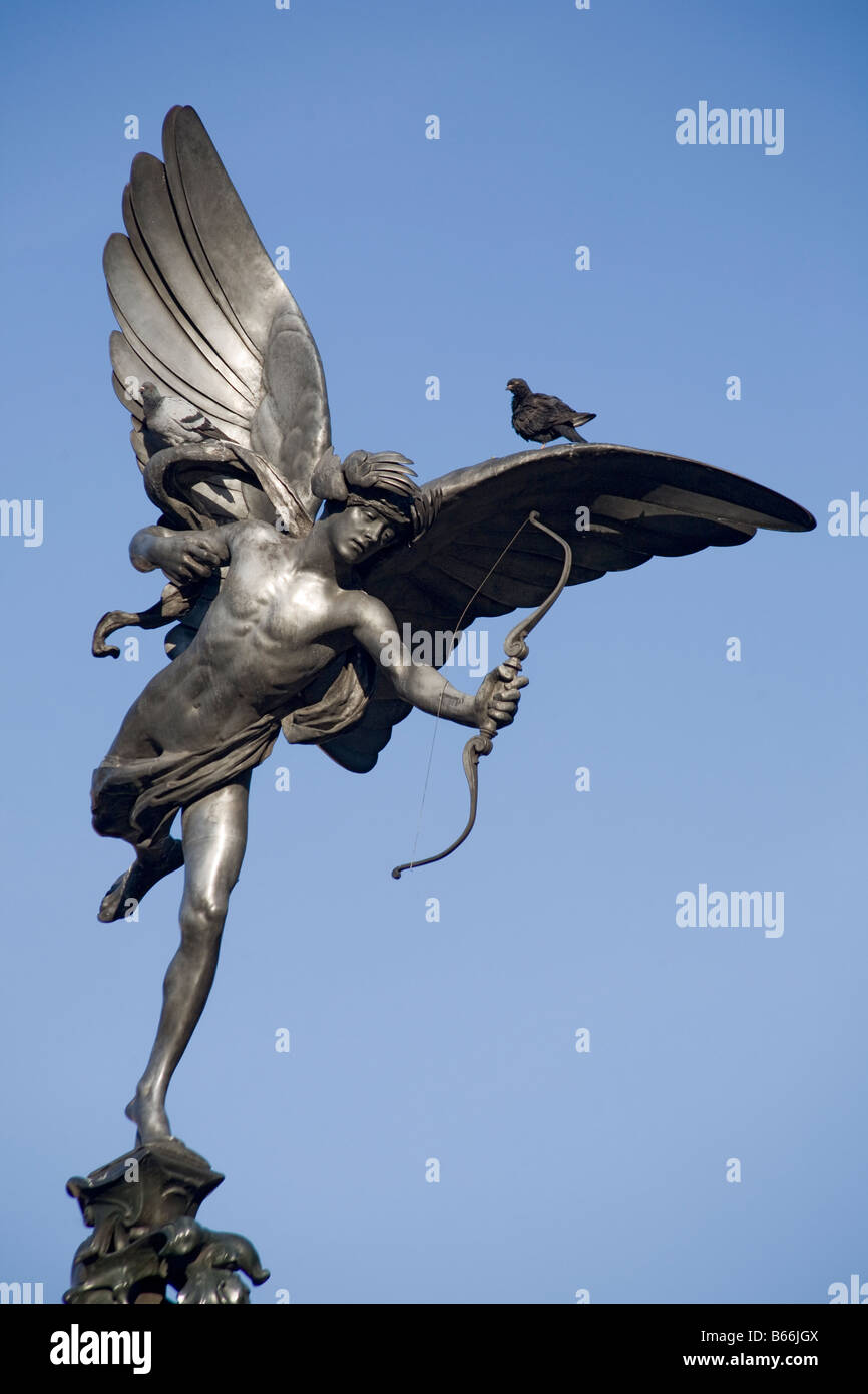 Two pigeons sitting on statue of Eros Piccadilly Circus London England UK - Stock Image