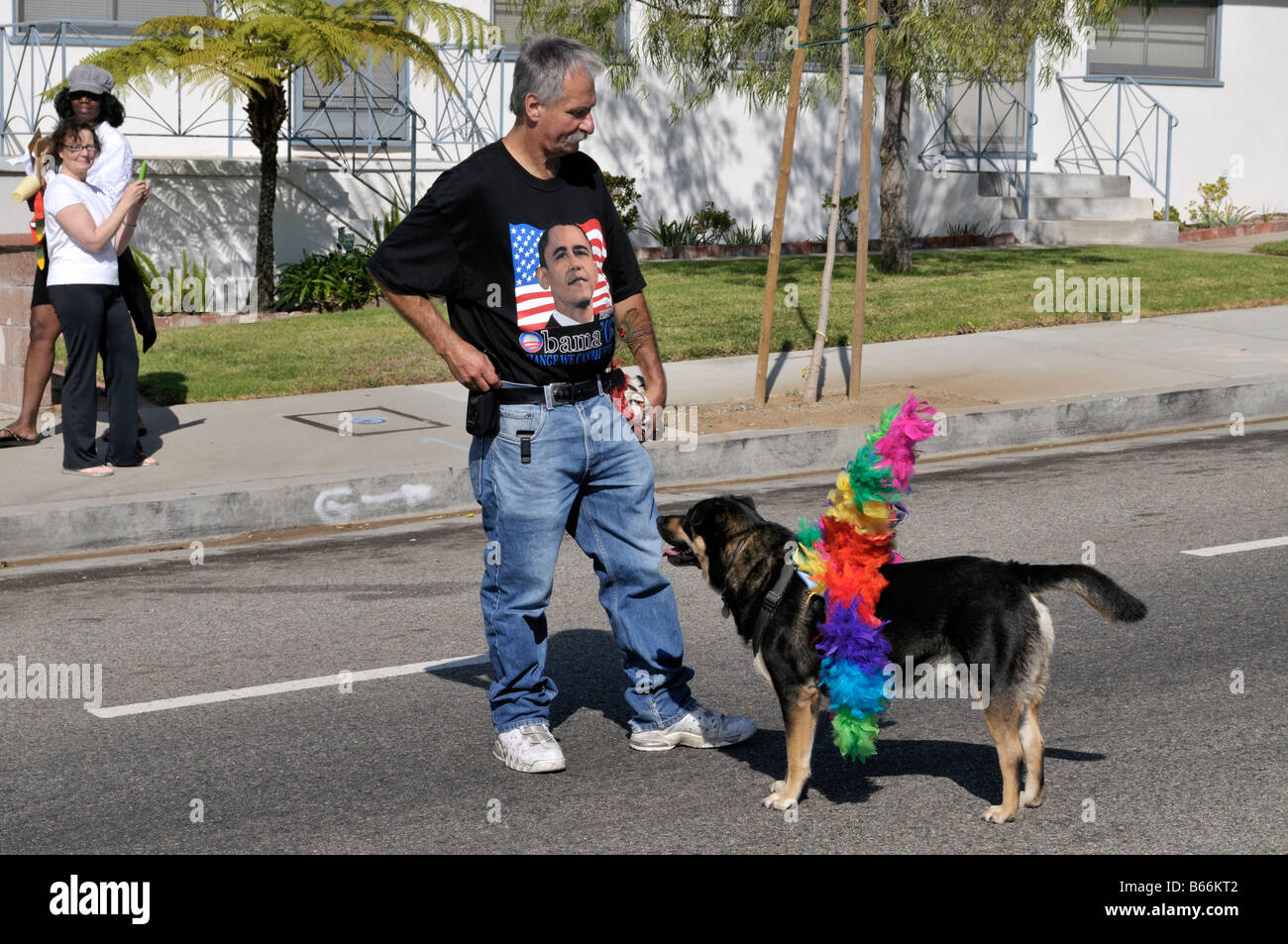 A local resident of Westchester, Los Angeles, California having fun with his obedient dog Stock Photo
