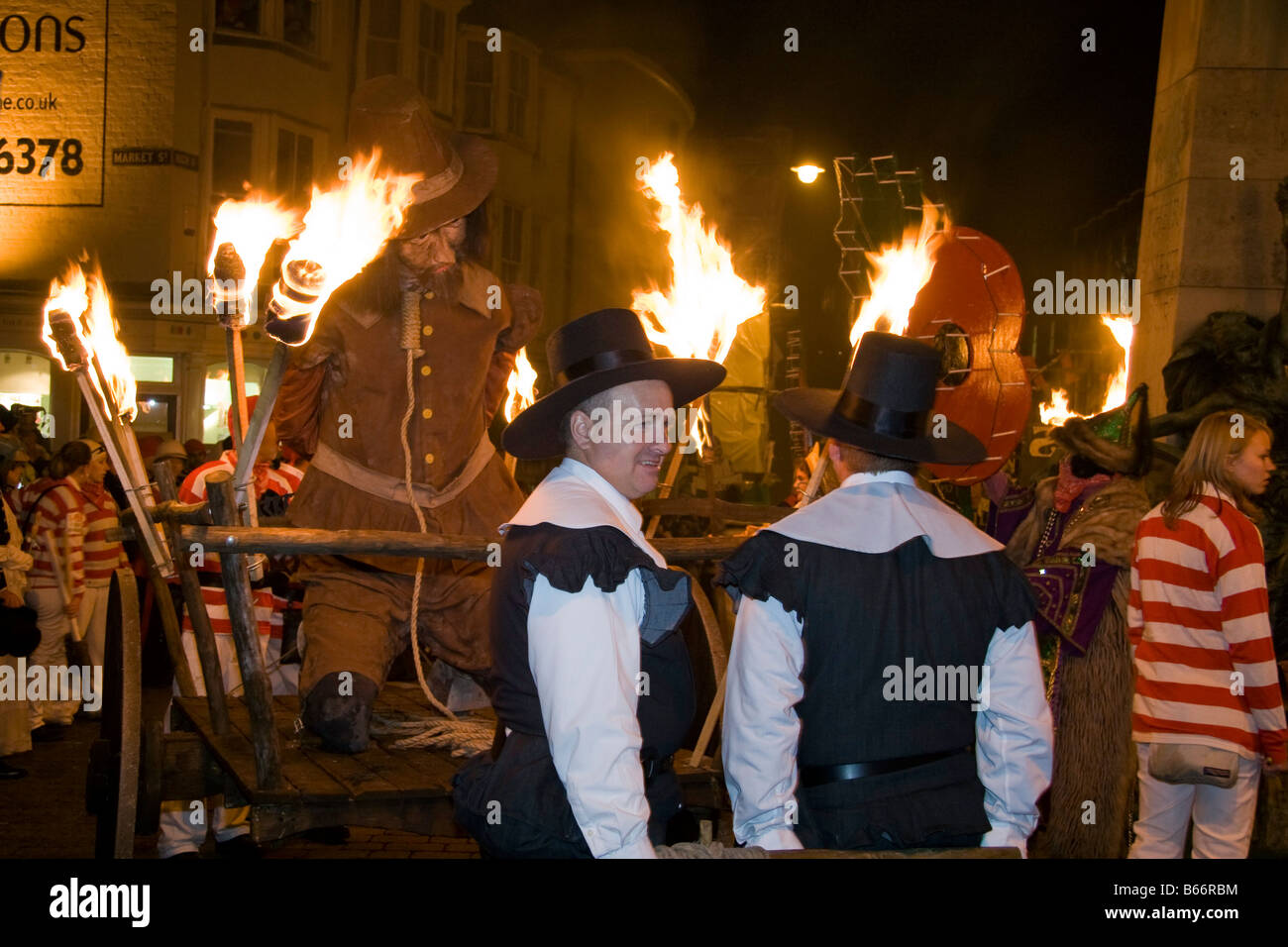 Guy Fawkes effigy on a cart with a noose around his neck. Lewes bonfire night, November 5th procession. - Stock Image