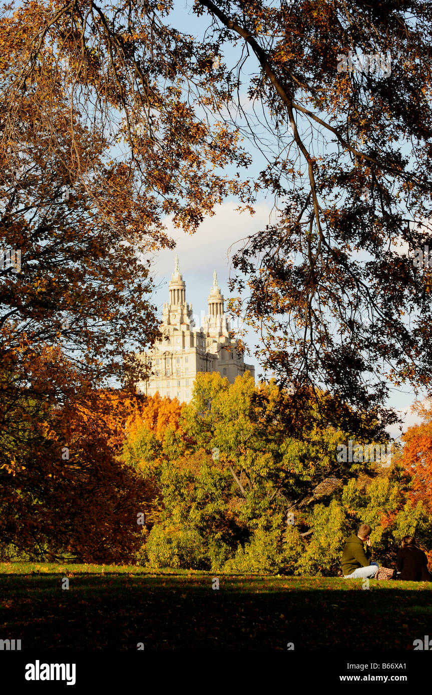 Autumn trees Central Park New York and the San Remo building designed by Emery Roth USA - Stock Image
