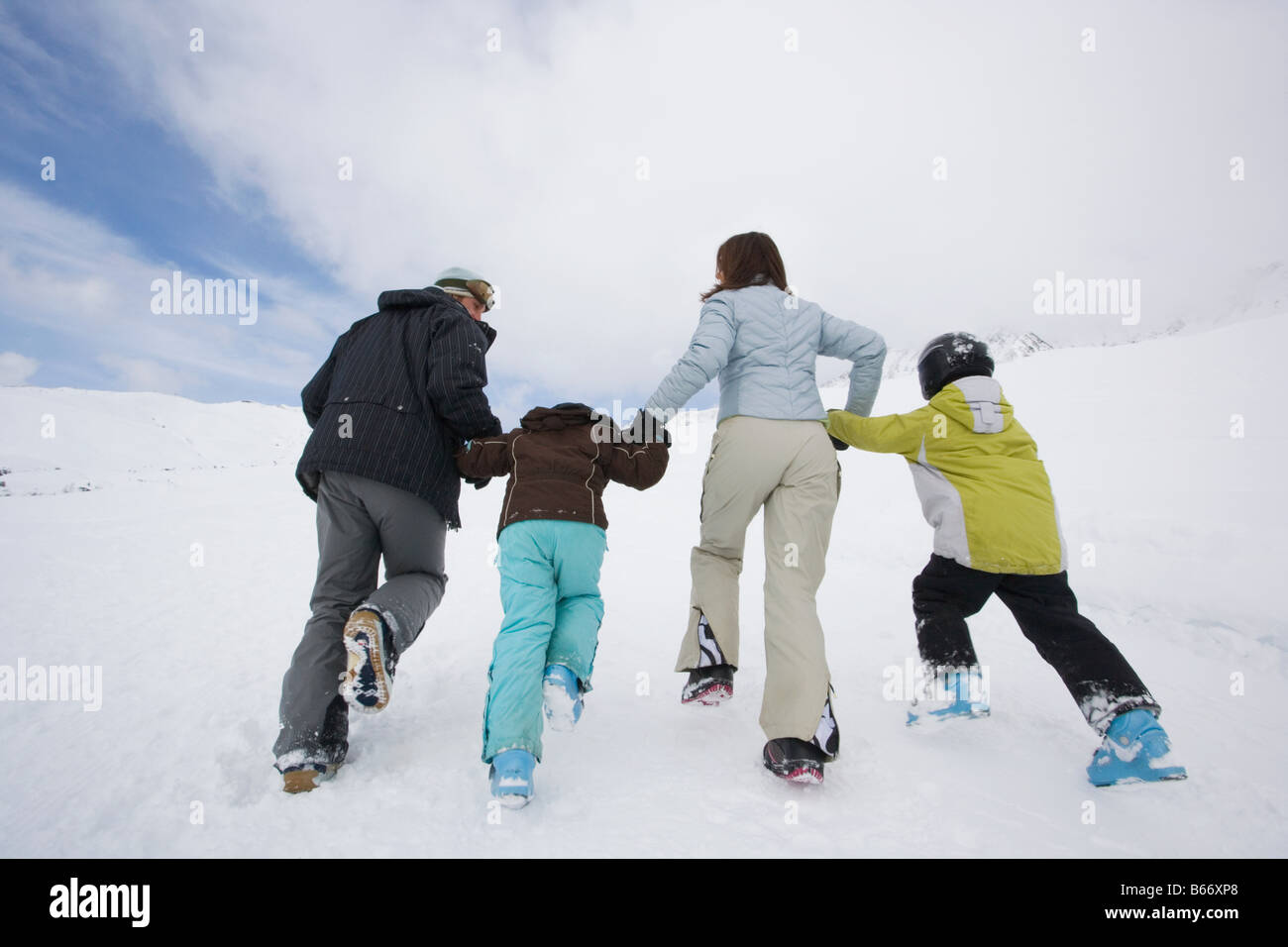 Family in the snow - Stock Image