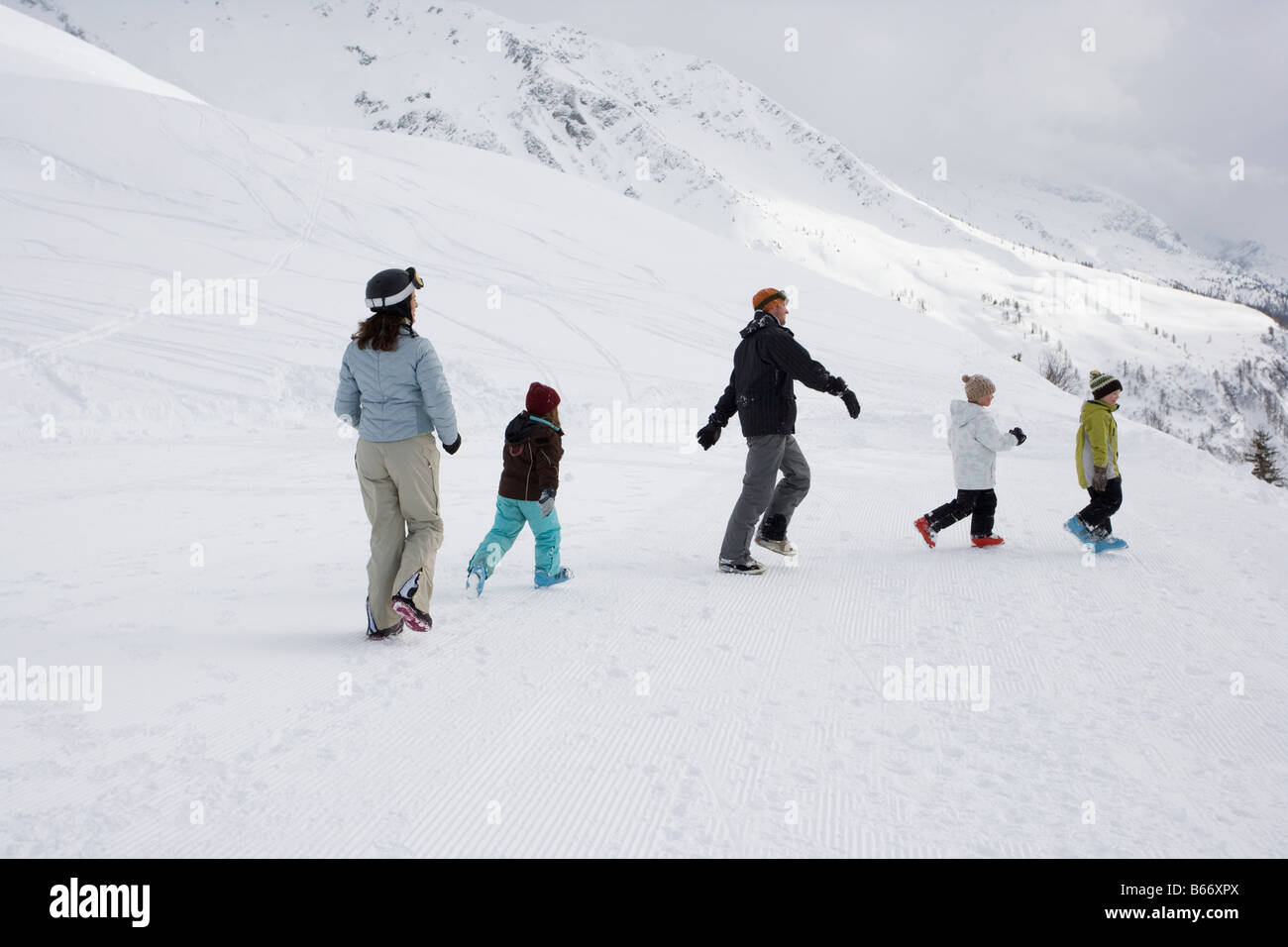 Family walking in the snow Stock Photo