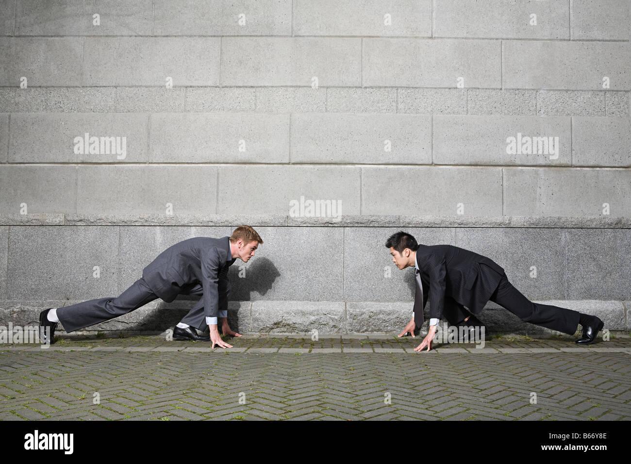 Rival businessmen - Stock Image