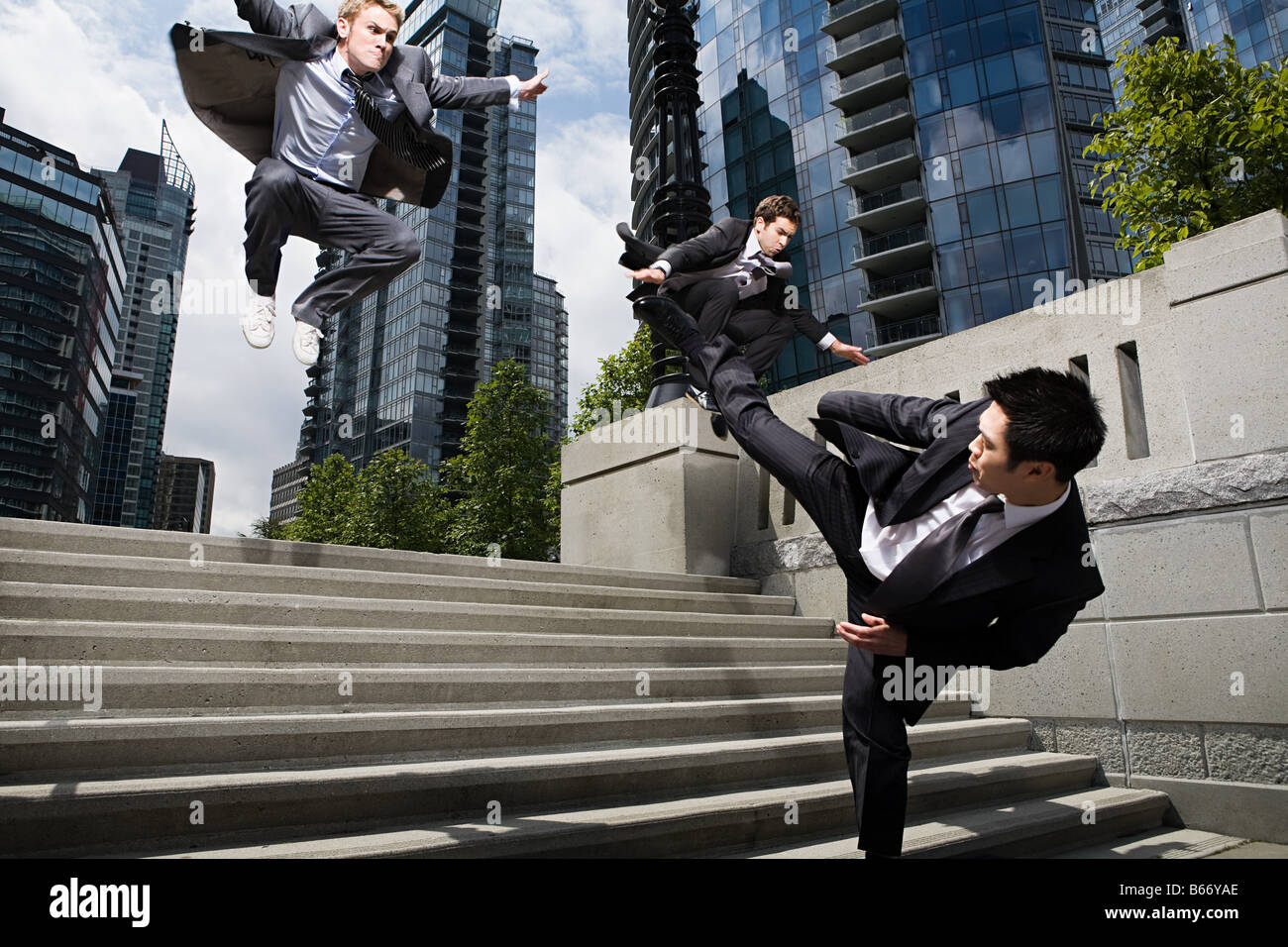 Businessmen fighting - Stock Image