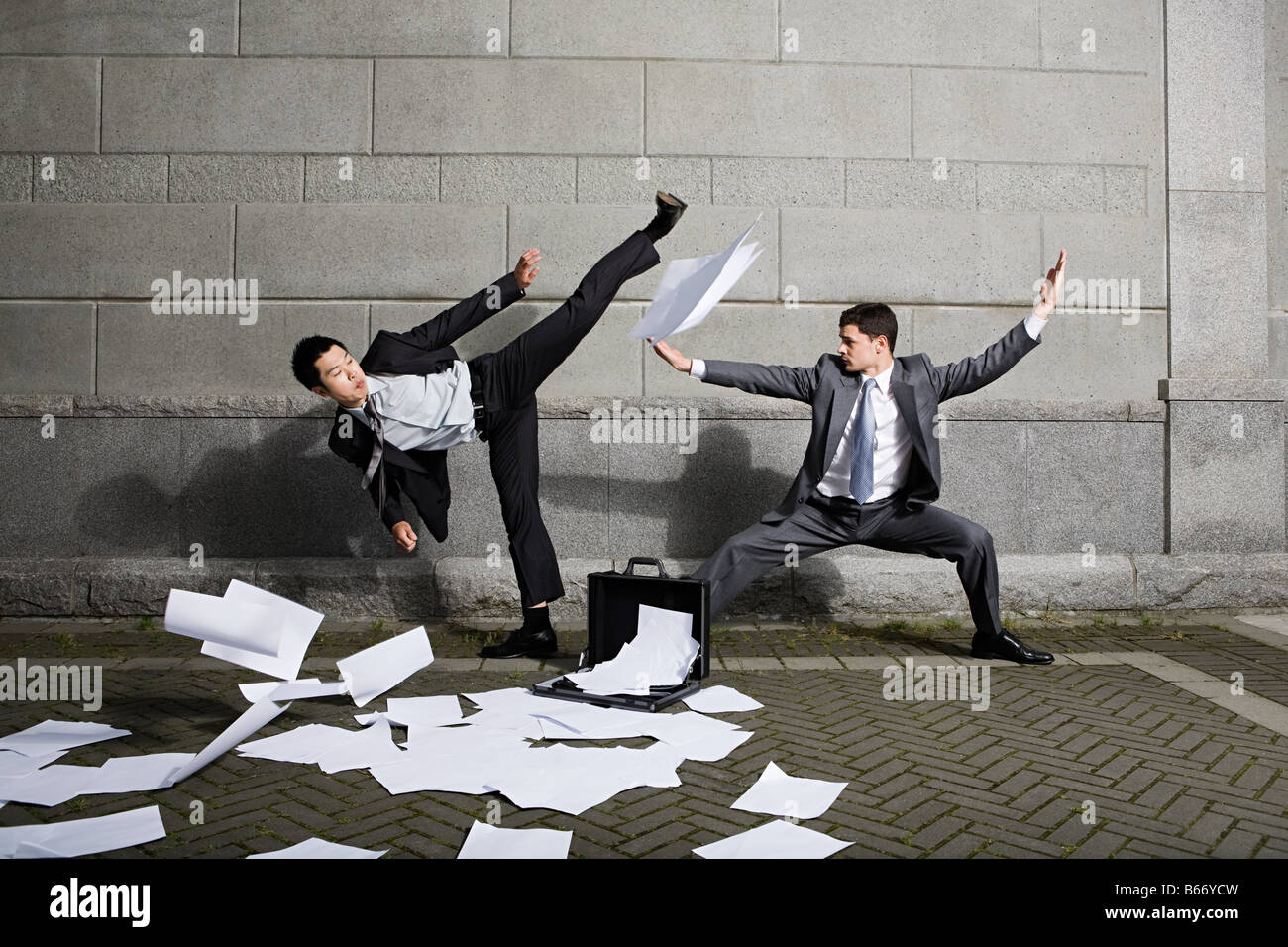 Businessmen fighting - Stock Image