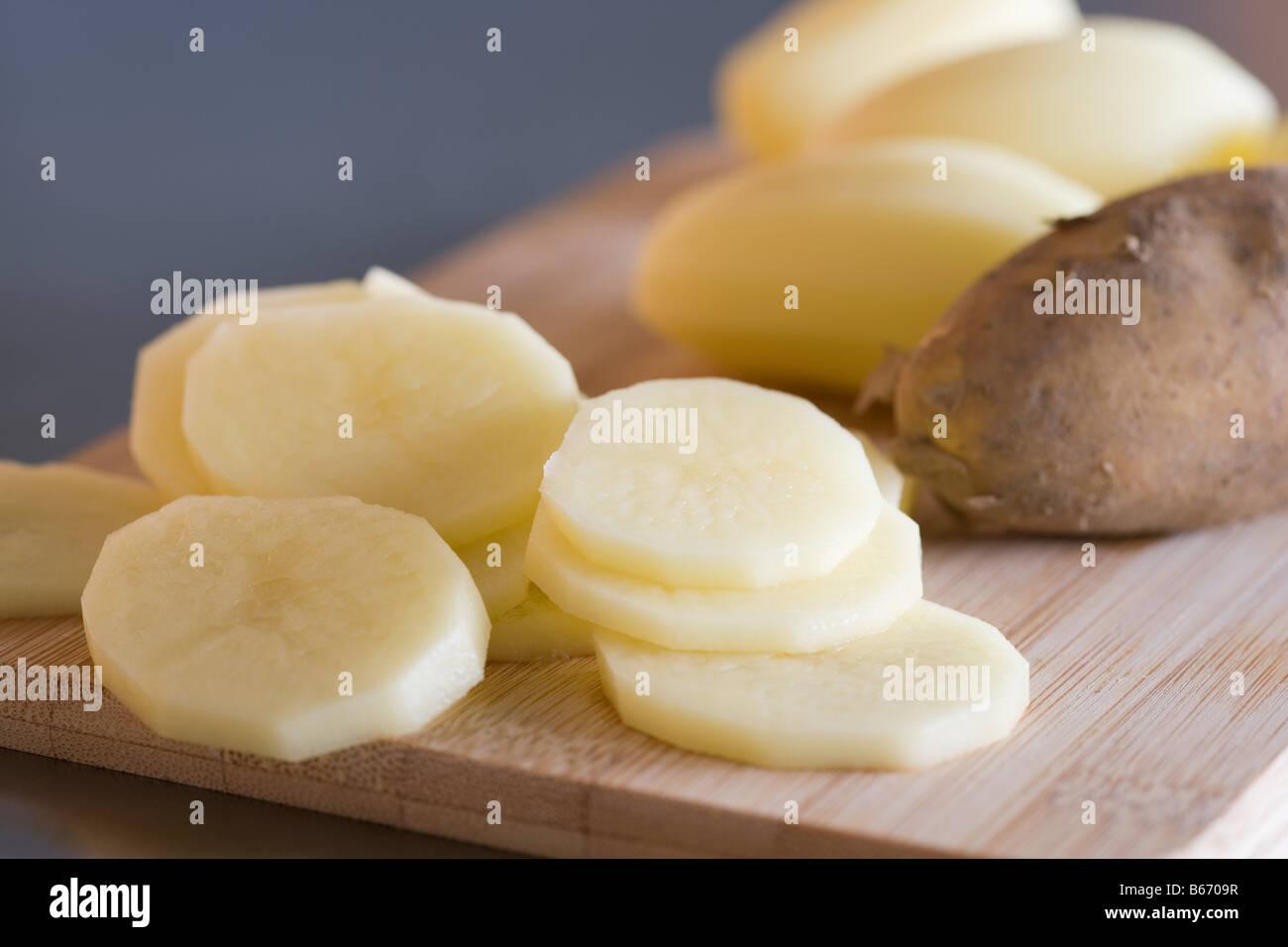 Slices of raw potato - Stock Image