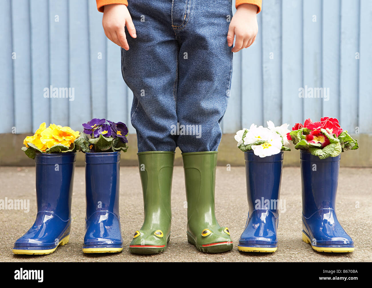 Child and rubber boots Stock Photo