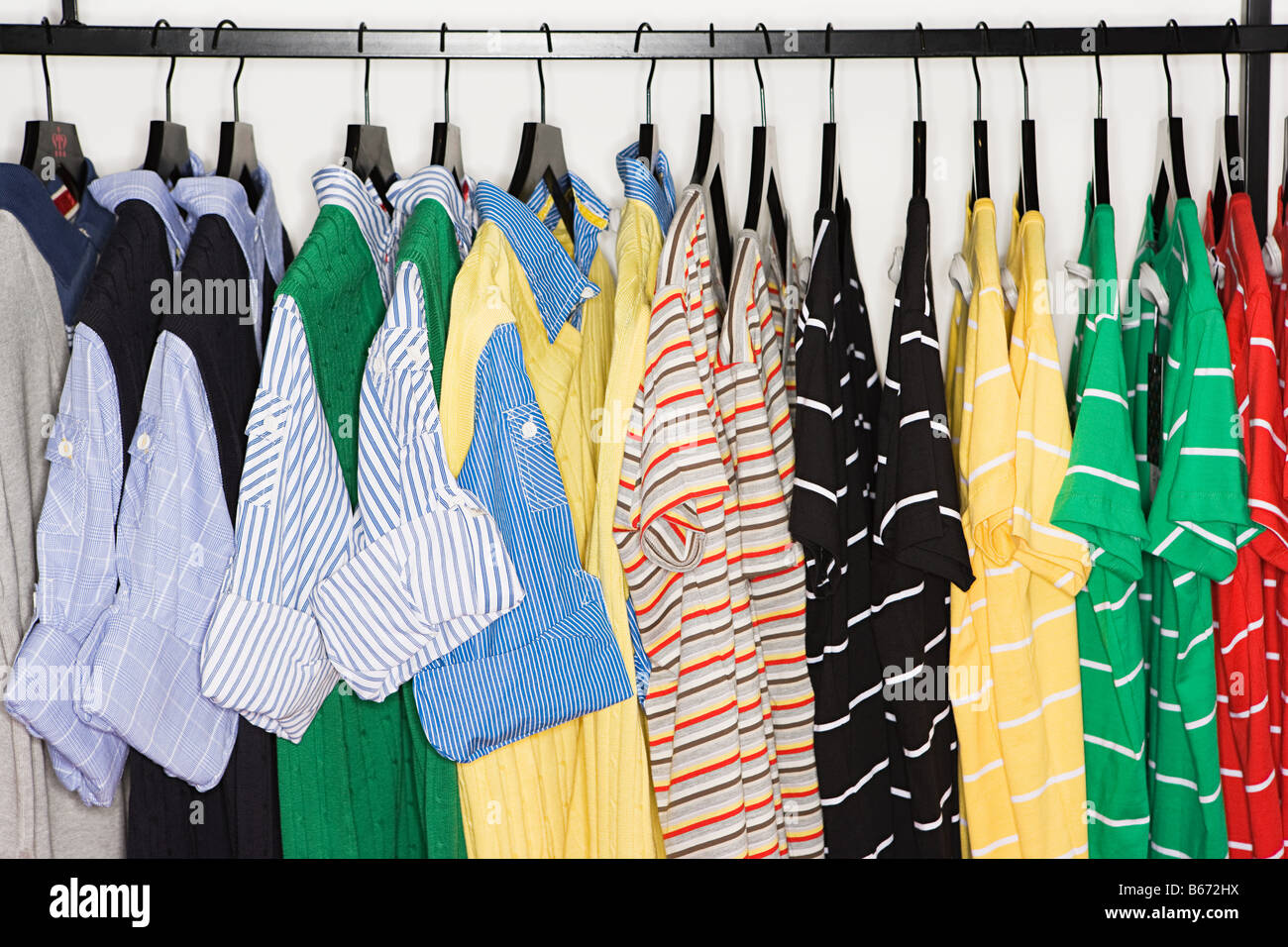 T-shirts on a clothes rail - Stock Image