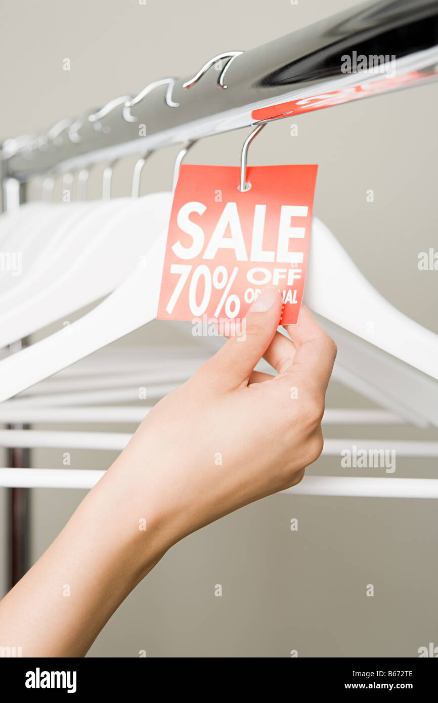 Woman holding a sales label - Stock Image