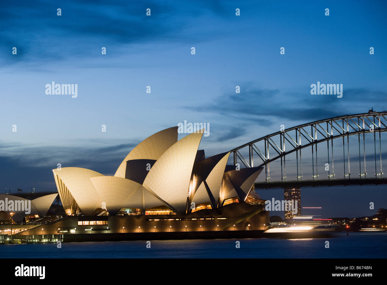 Sydney opera house and harbour bridge at night - Stock Image