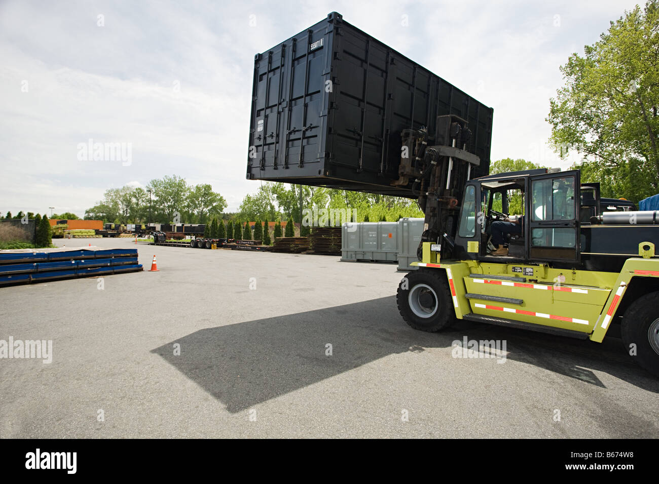 Forklift truck with cargo container - Stock Image