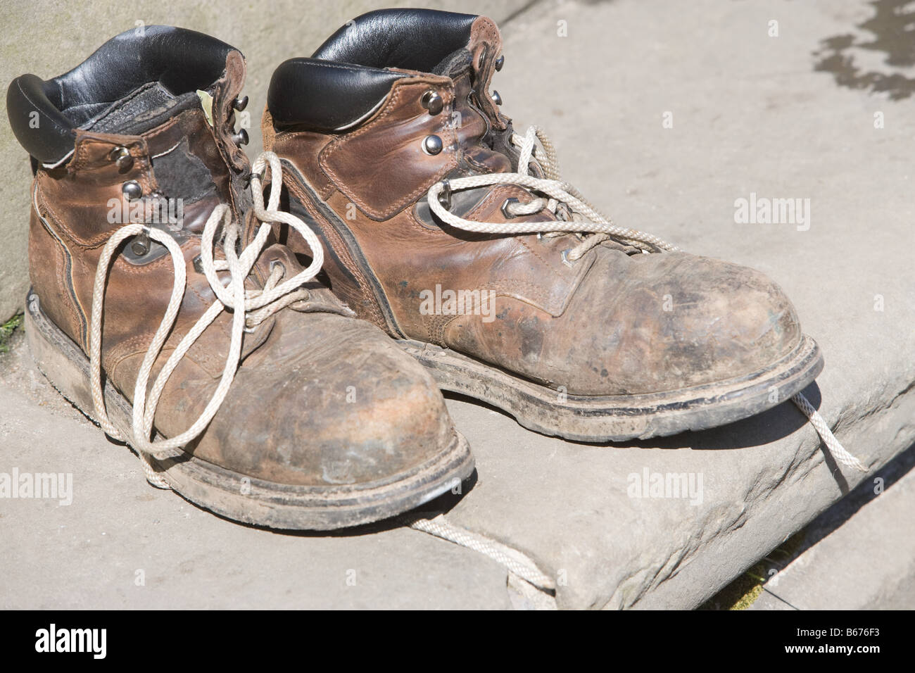 Worn boots - Stock Image