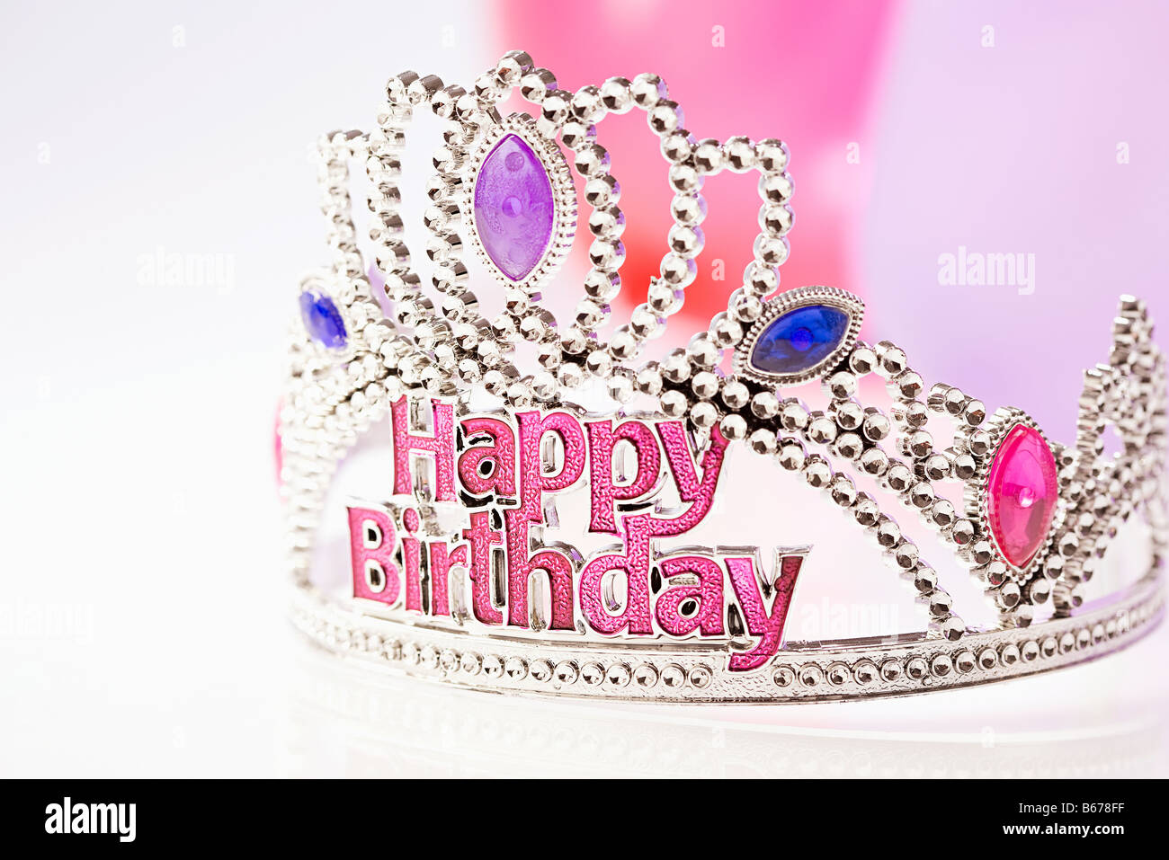 Happy birthday crown and balloons - Stock Image