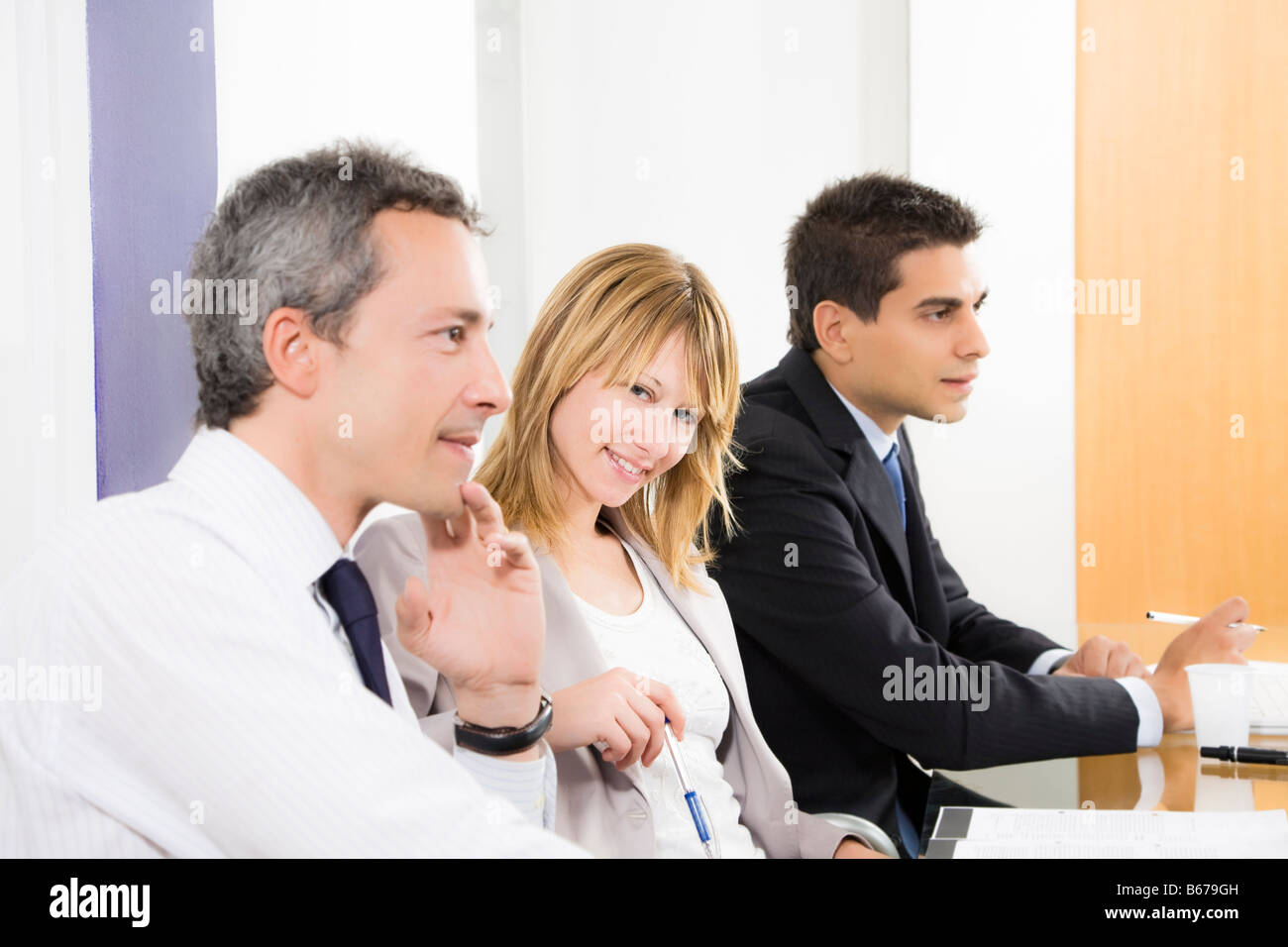 Portrait of business woman among colleagues in meeting - Stock Image