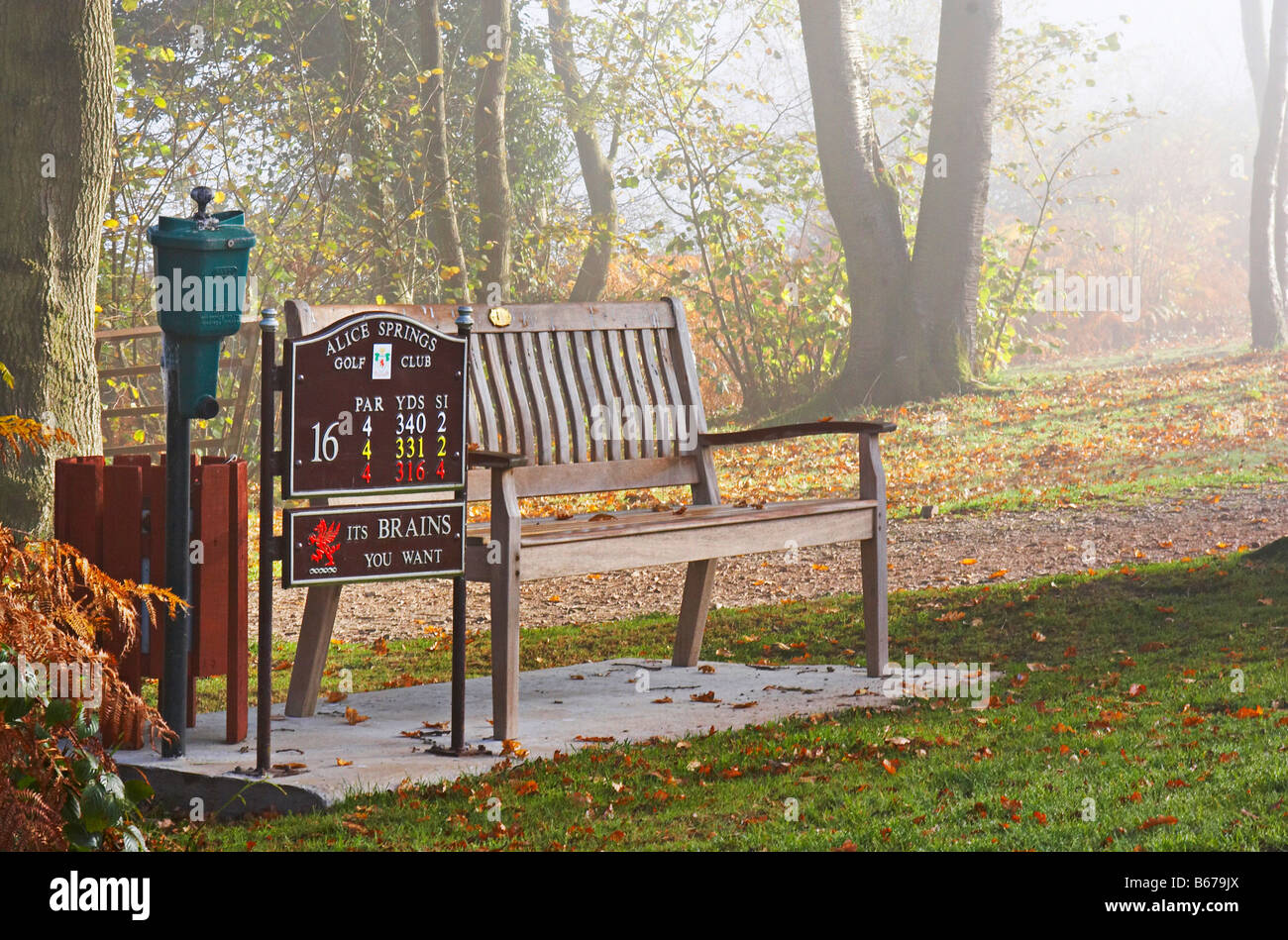 The bench at the tee on the 16th hole on the Monnow golf course in Usk South Wales Stock Photo