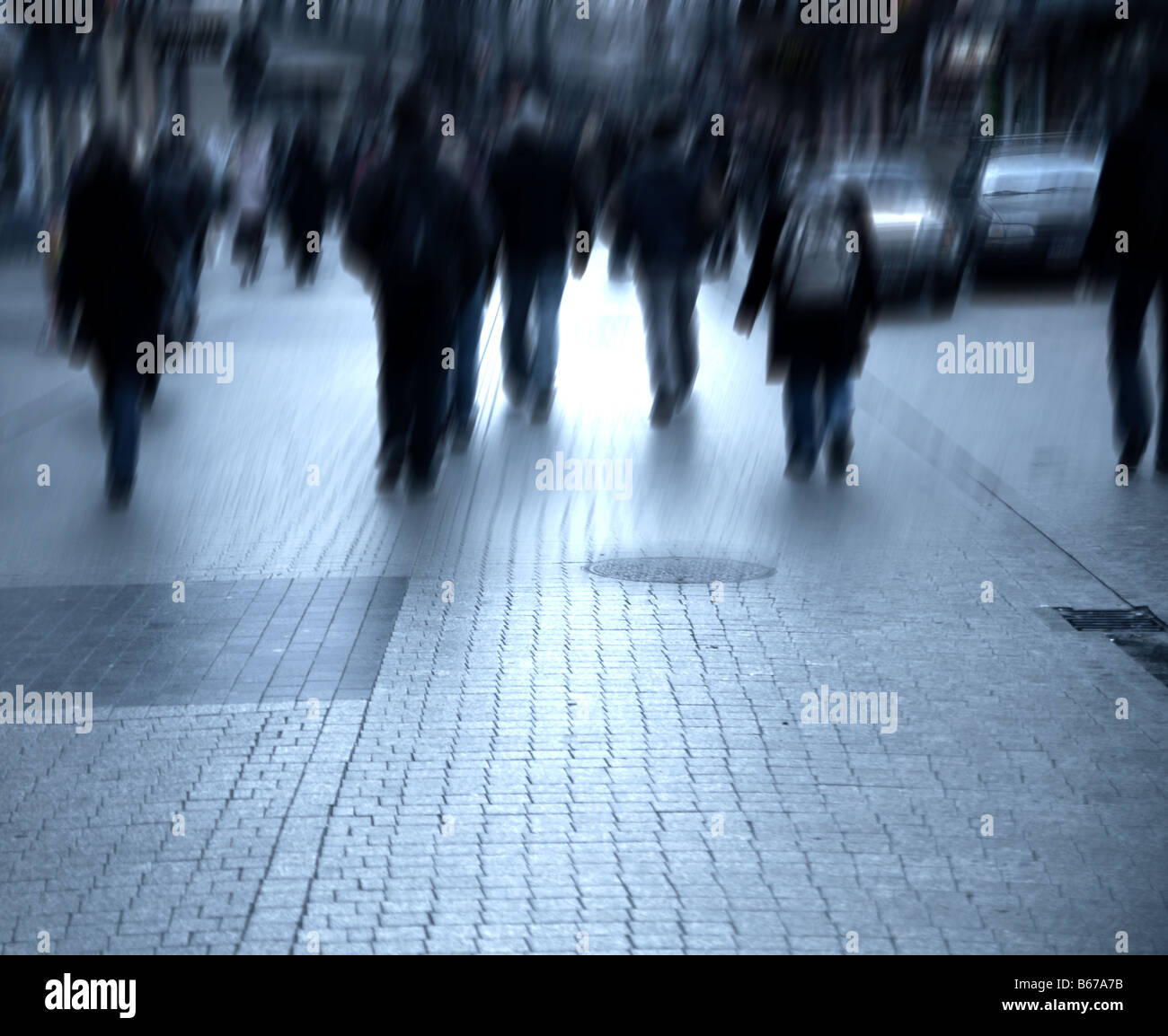 Busy big city street. Motion blurred with lens - Stock Image