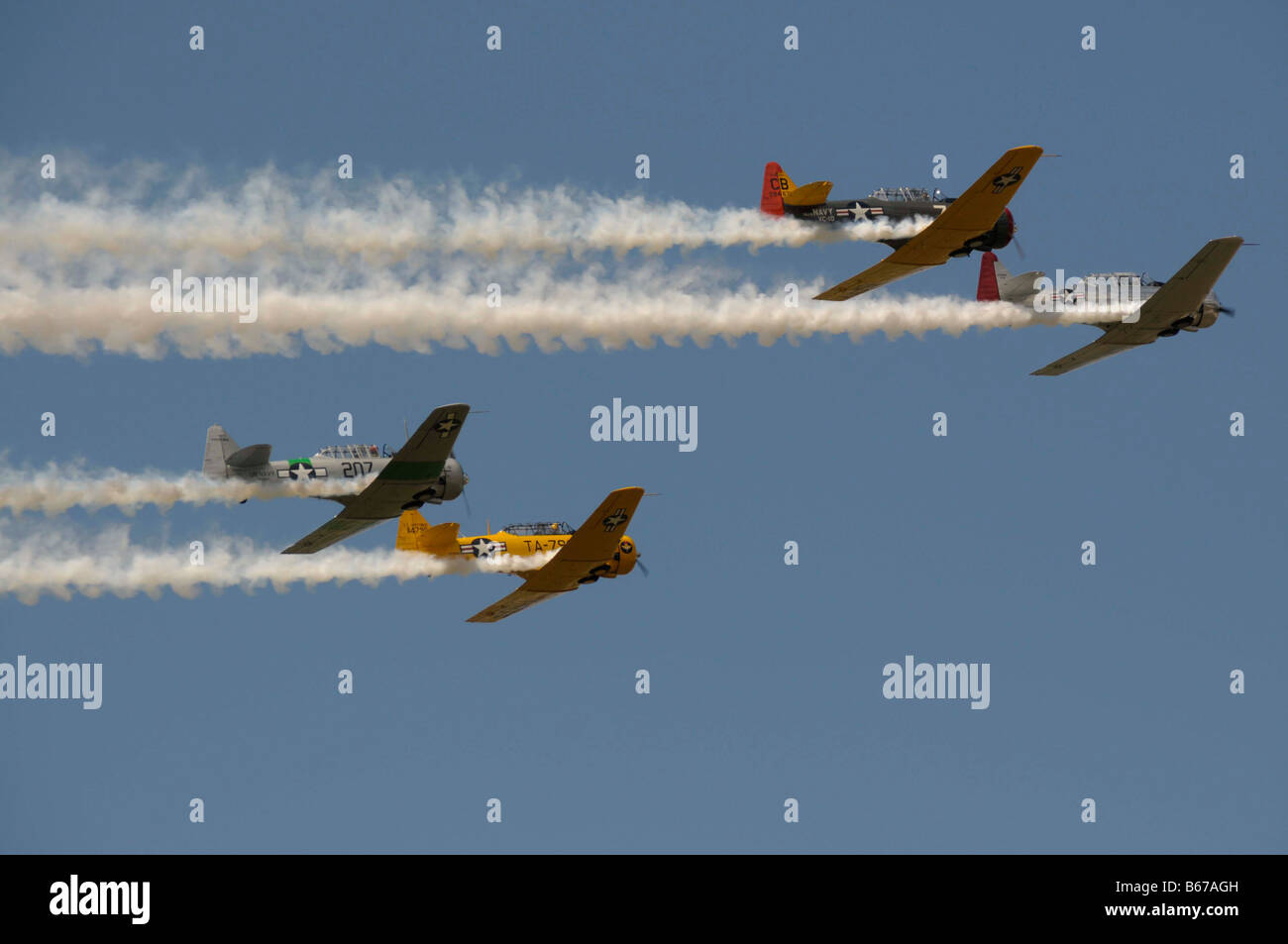 The North American T-6 Texan wwII airplanes in an airshow at the Willow Run airport in Bellville, Michigan - Stock Image
