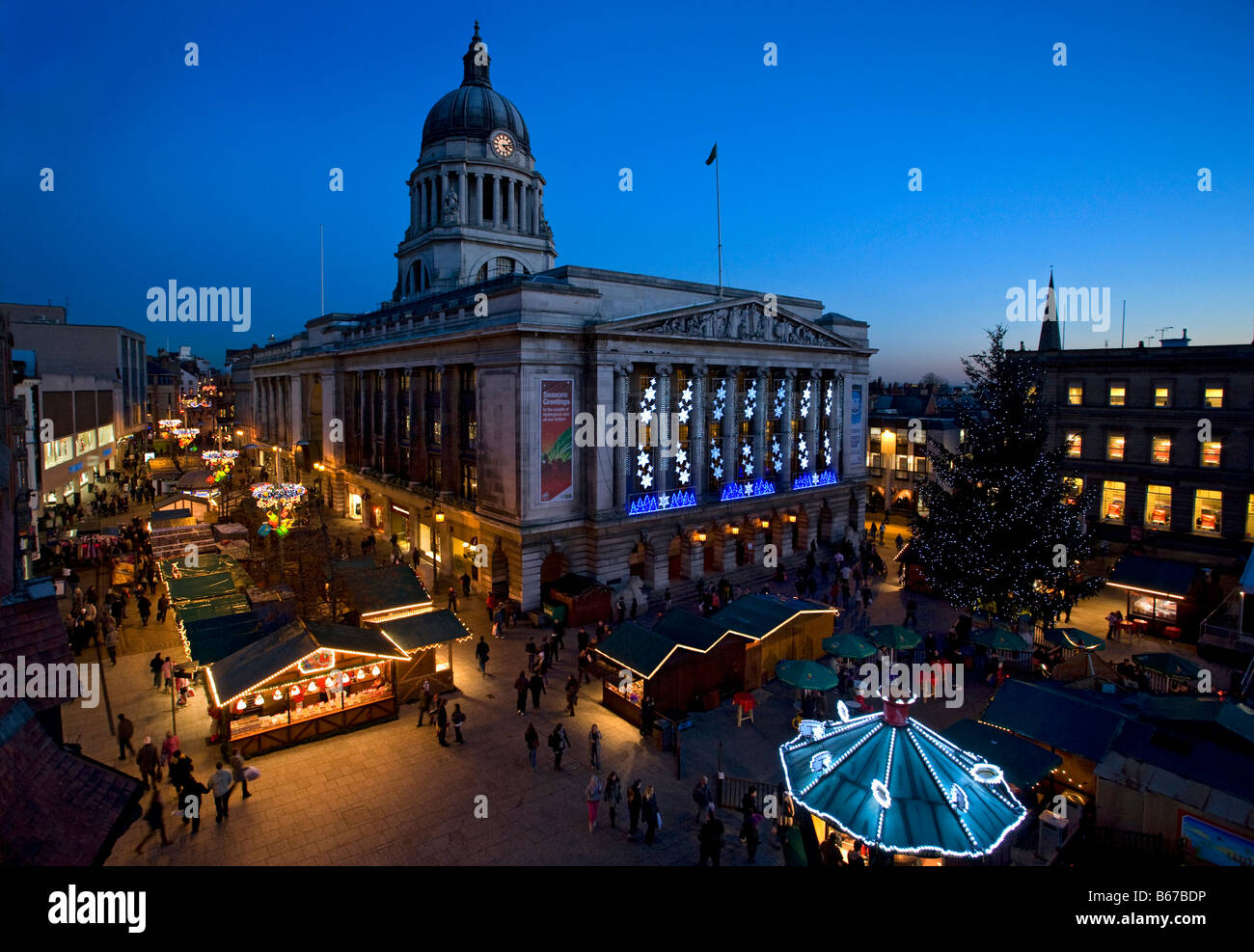 Nottingham town hall with Christmas lights and market,england - Stock Image