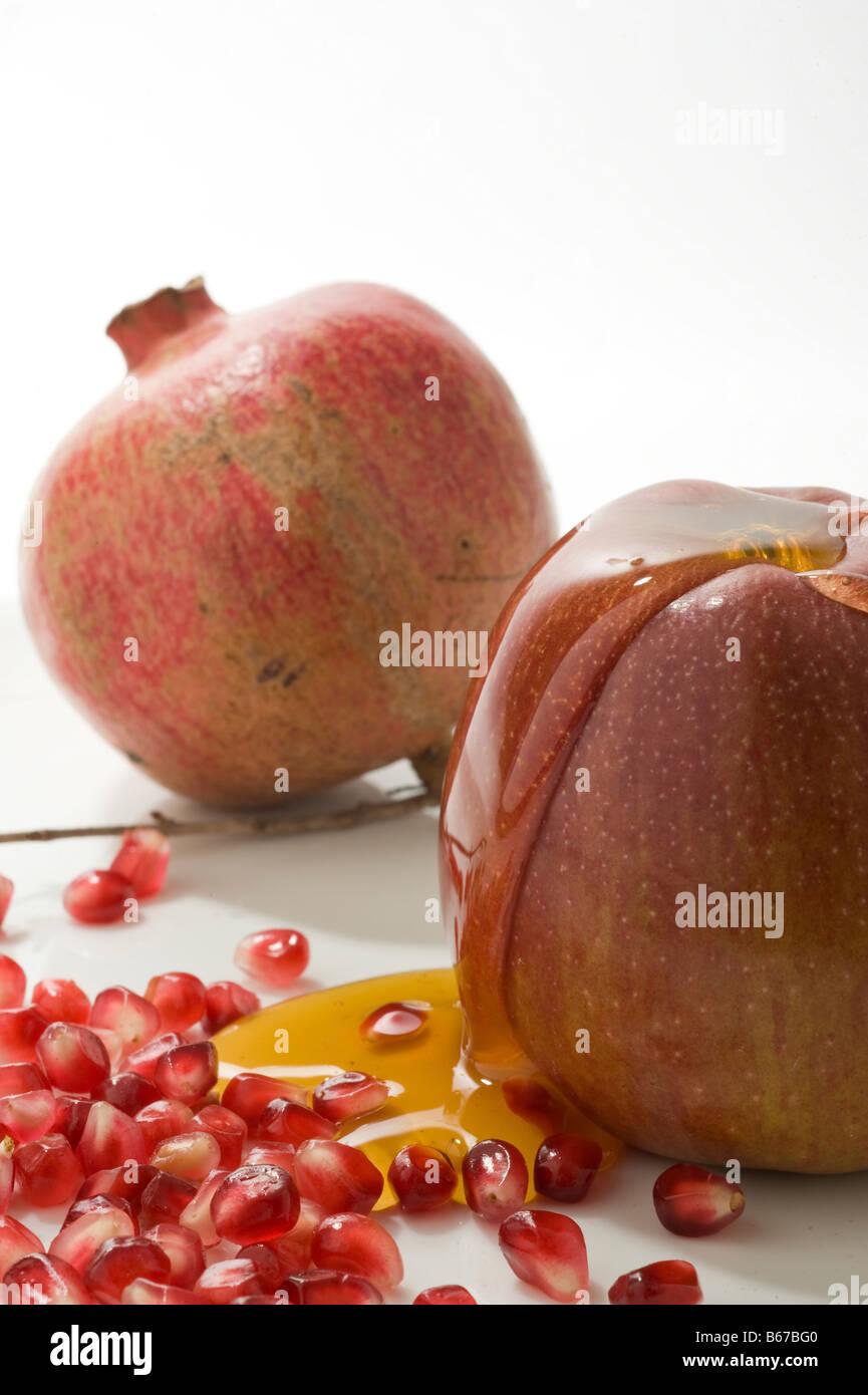 Apple Pomegranate Seeds And Honey Symbols Of Roah Hashanah The