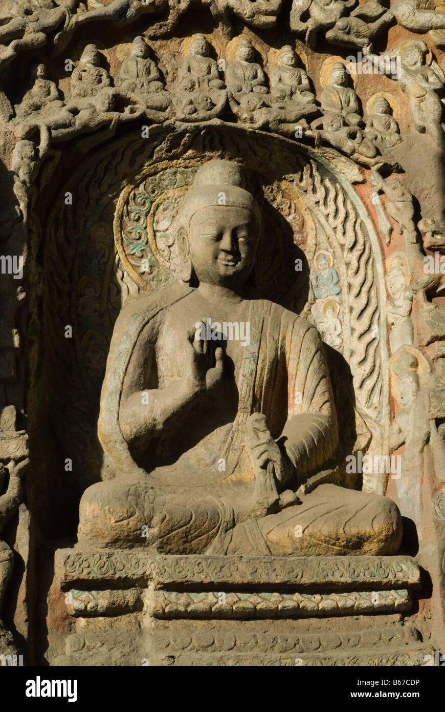Buddha effigy at Yungang Grottoes, Datong, Shanxi , China - Stock Image