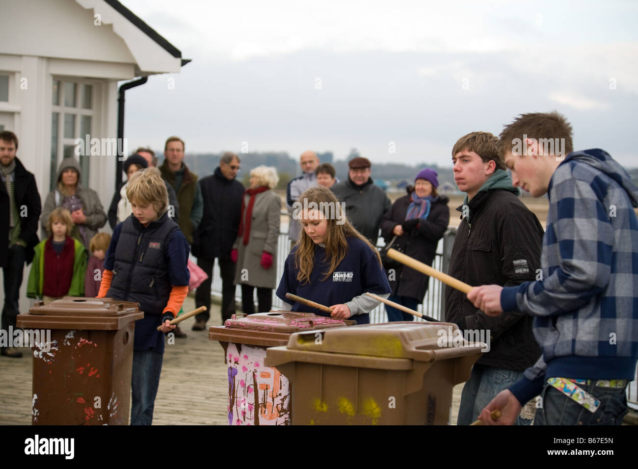 A youth band drumming on dustbins on the Pier, Southwold, Suffolk, England - Stock Image