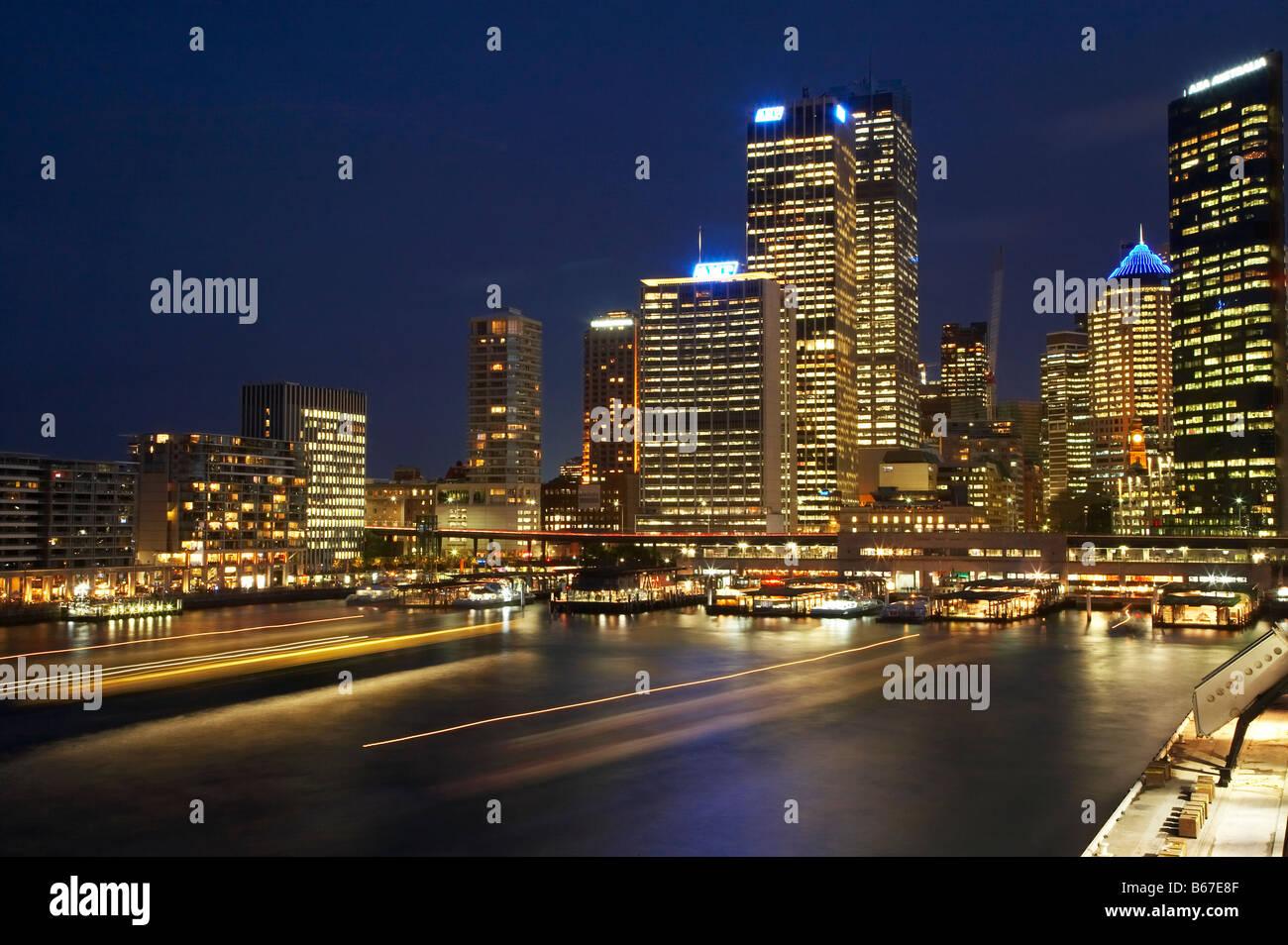 Sydney CBD and Passenger Ferry Terminal at Night Circular Quay Sydney Cove Sydney New South Wales Australia - Stock Image