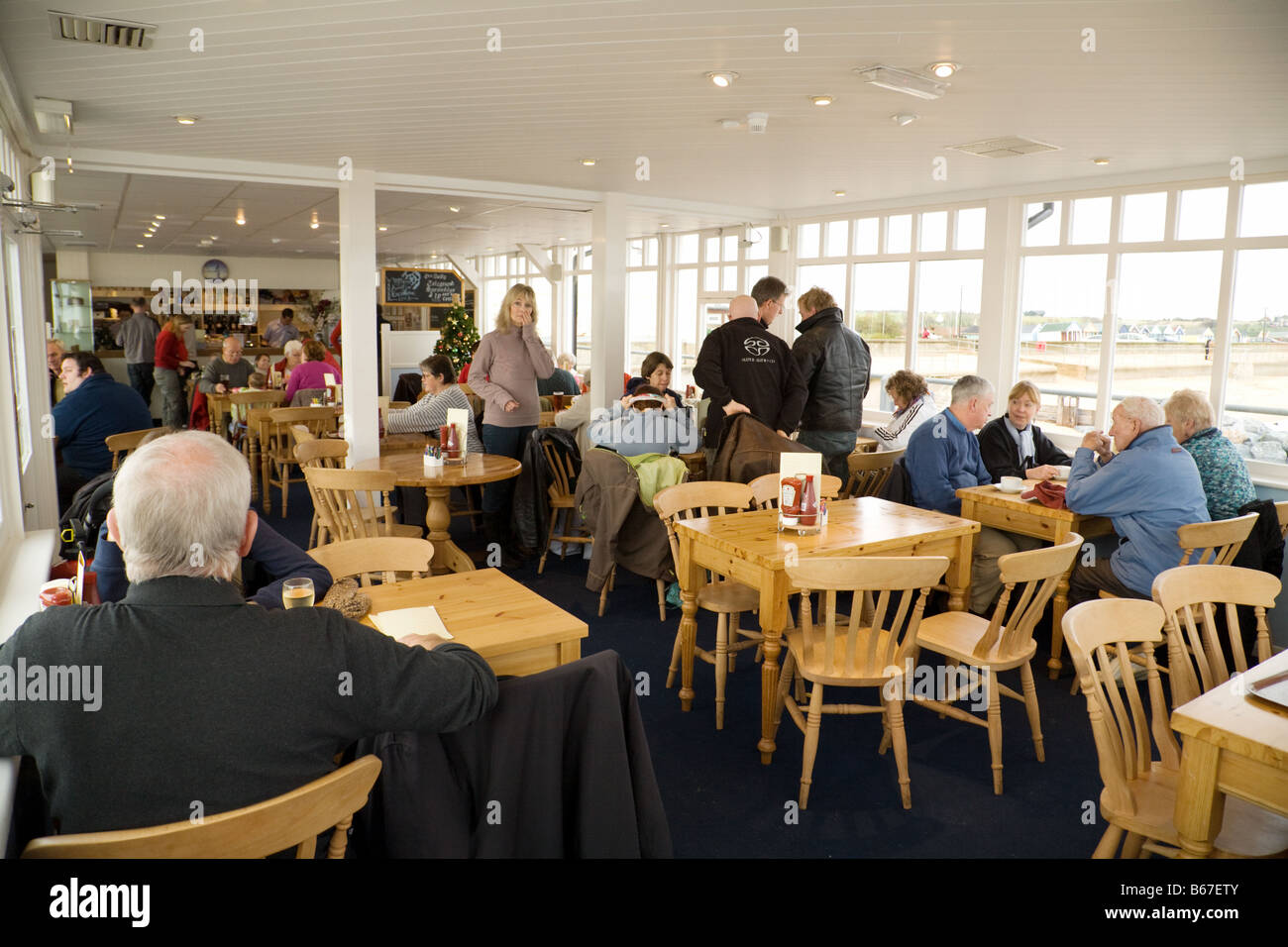 People having coffee in the cafe, The pier, Southwold, Suffolk, England - Stock Image