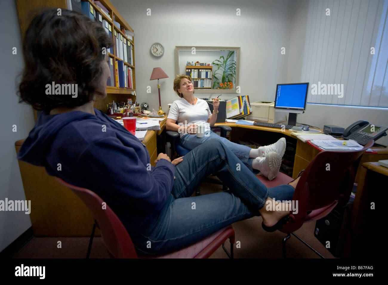 iranian professor at saddleback college relaxing at office in
