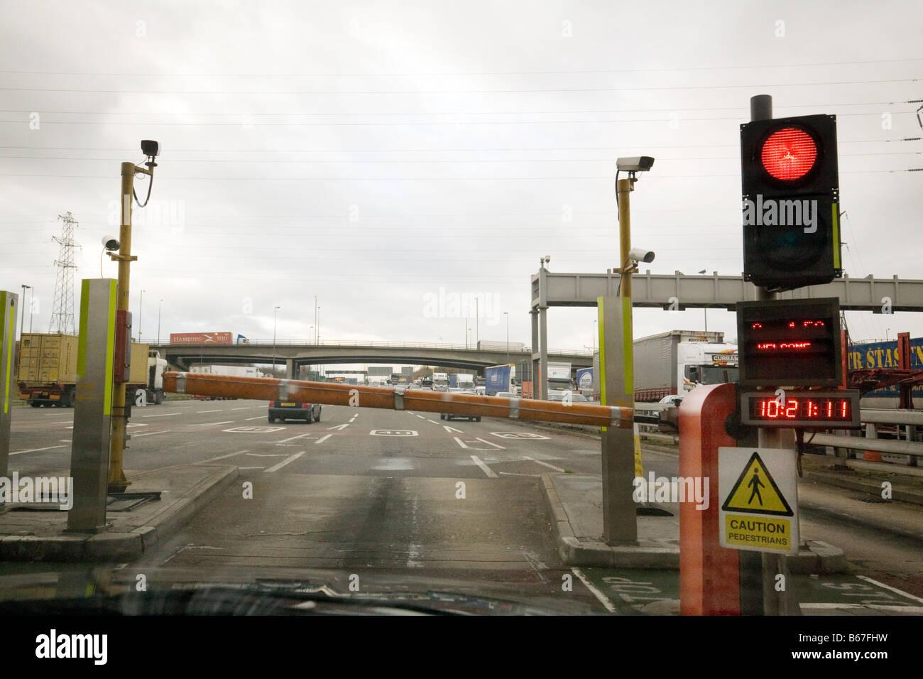 A red traffic light at the Dartford Crossing toll tolls, Dartford Kent, England UK Stock Photo
