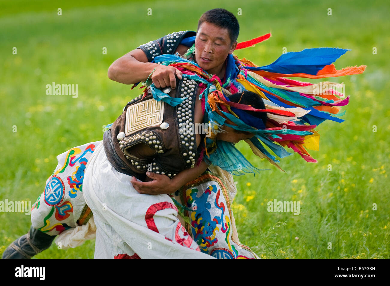 Mongolian wrestlers at summertime Naadam Festival Xiwuzhumuqinqi Inner Mongolia China - Stock Image