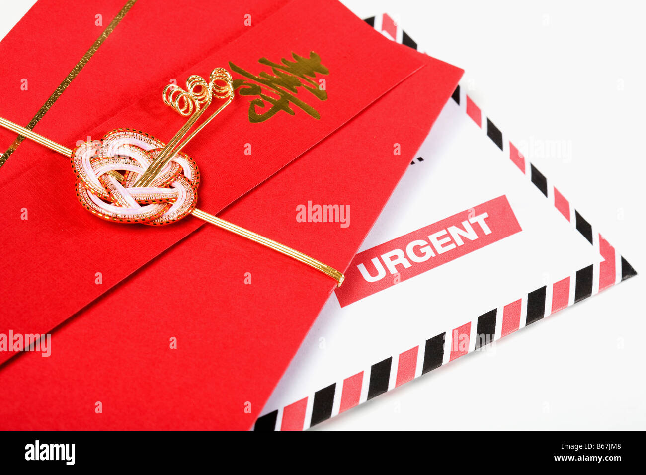 Close-up of a Chinese red envelope with a correspondence - Stock Image