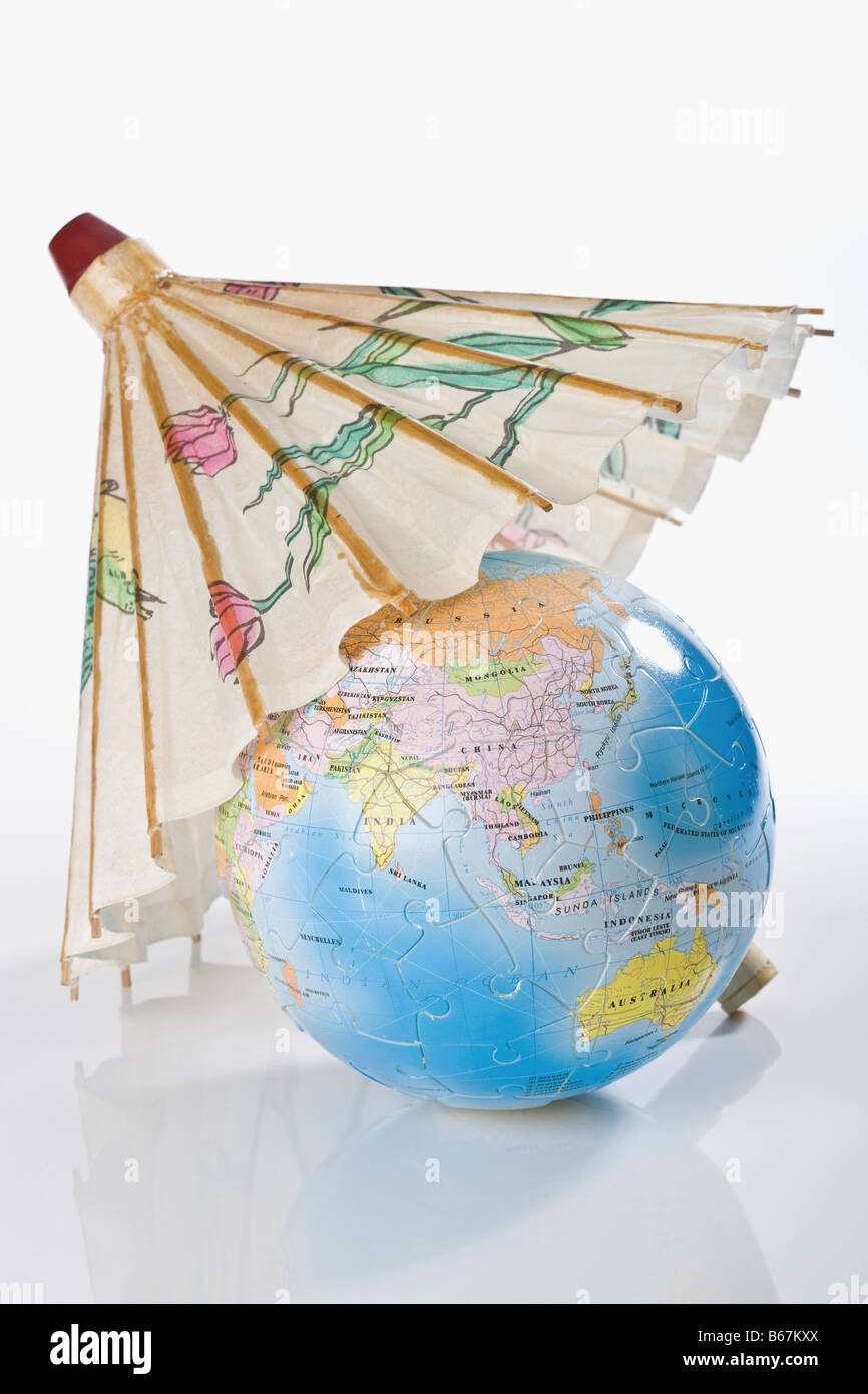 Globe covered by parasol - Stock Image
