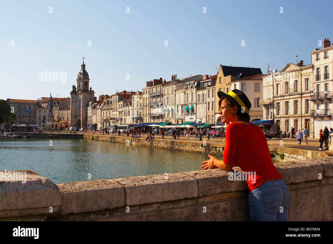 Grosse Horloge and bourgeois houses at the old harbour of La Rochelle, Charente-Vendée, dept Charente-Maritime, - Stock Image
