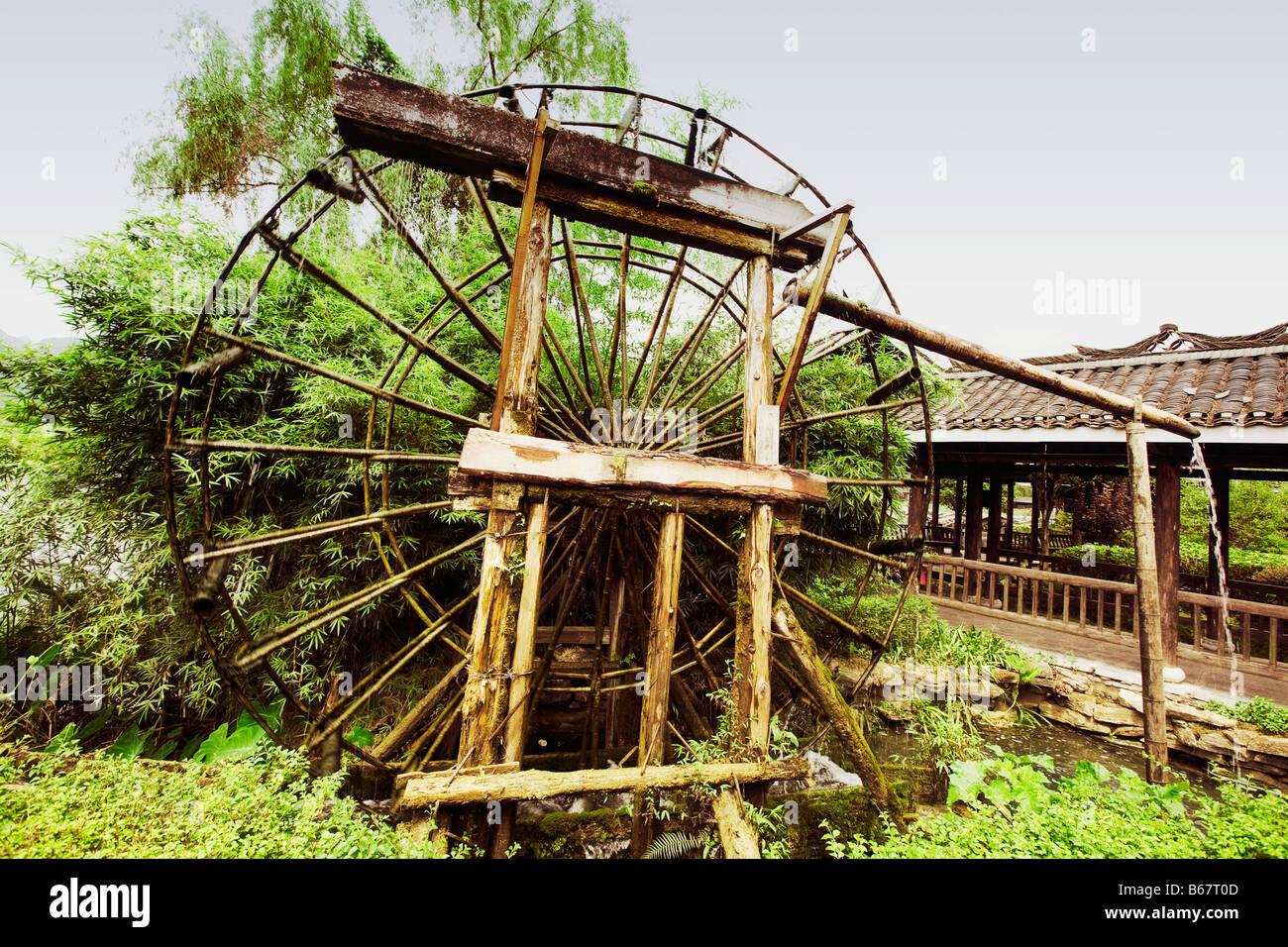 Watermill in a field, Yangshuo, Guangxi Province, China Stock Photo