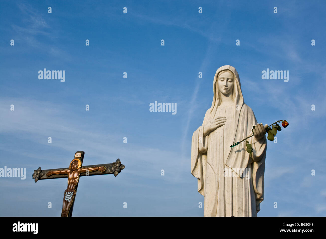 Blessed Virgin Mary statue and a cross in the sanctuary Medjugorje, Bosnia Herzegovina - Stock Image