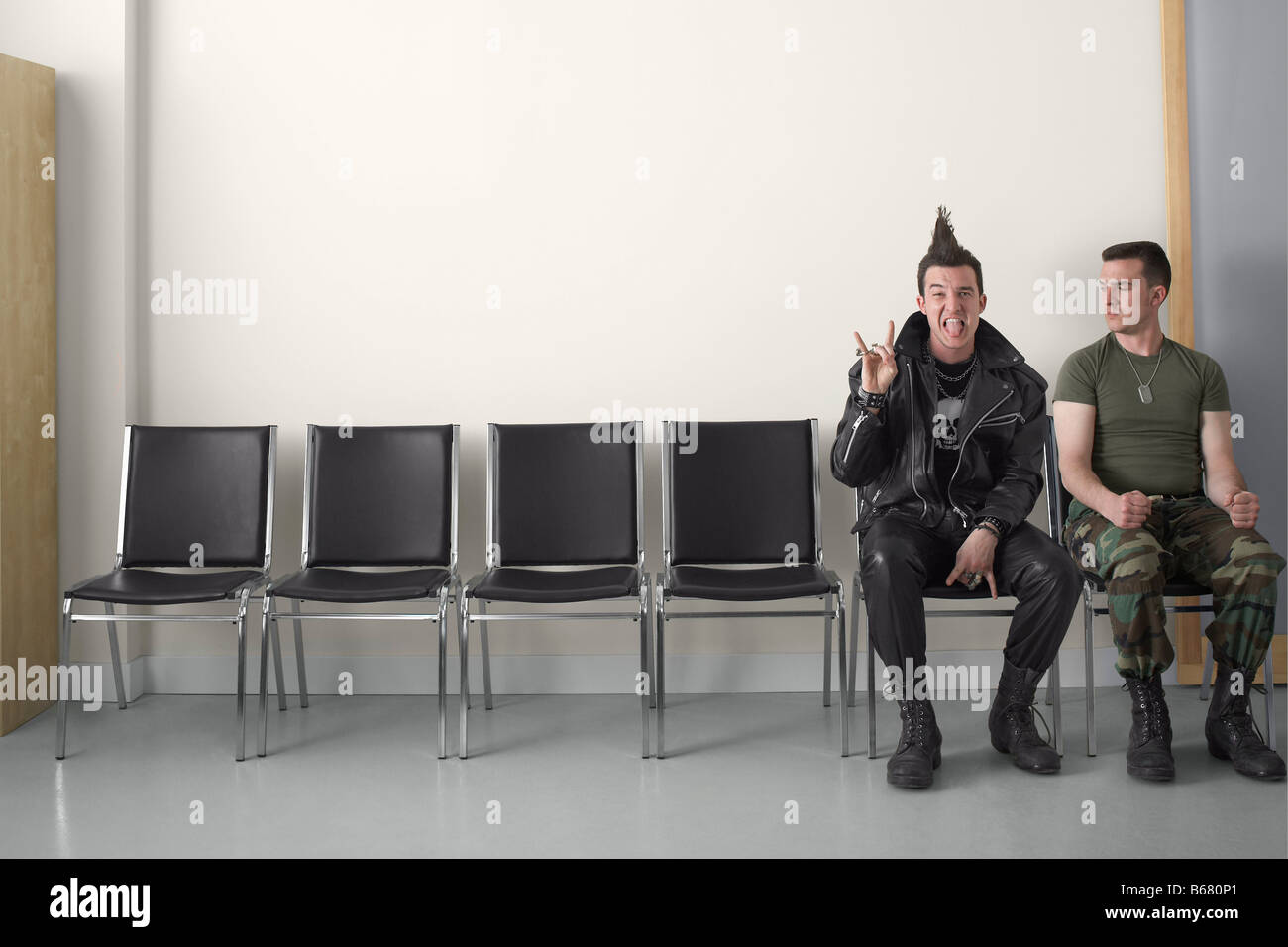 Punk and Soldier in Waiting Area Stock Photo