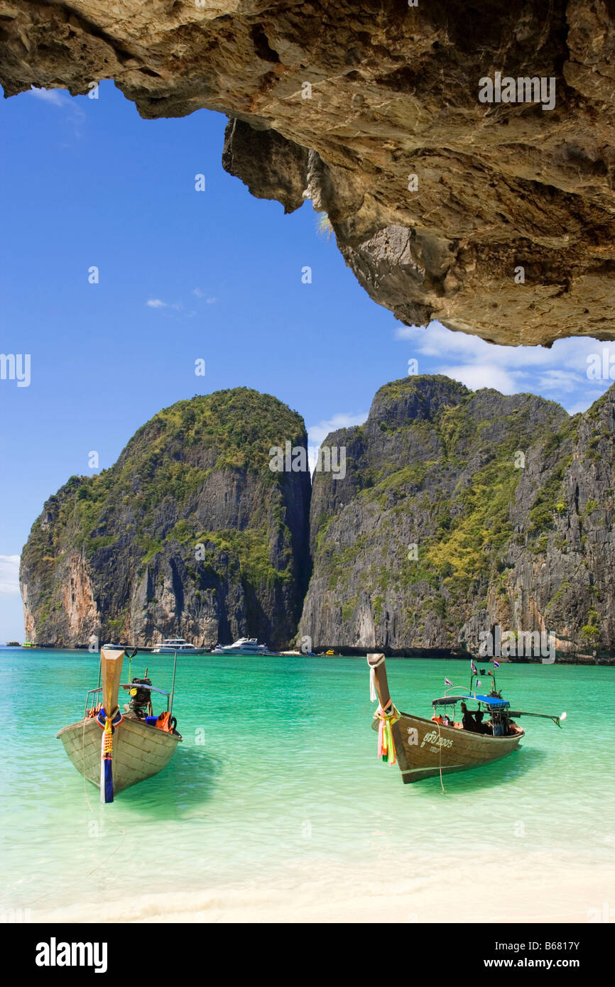 Two boats anchoring in the Maya Bay, a beautiful scenic lagoon, famous for the Hollywood film 'The Beach', - Stock Image