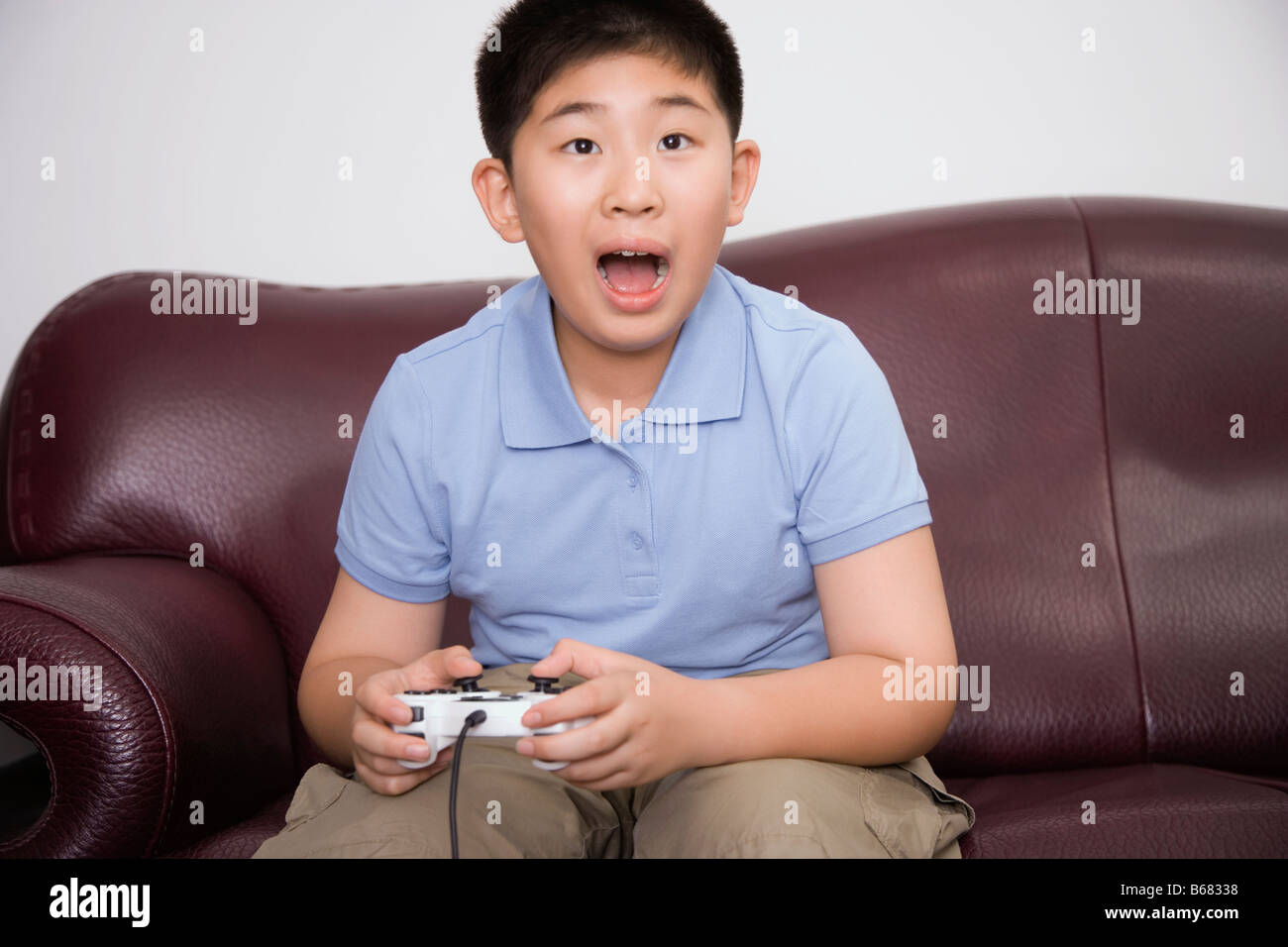 Boy playing video game - Stock Image