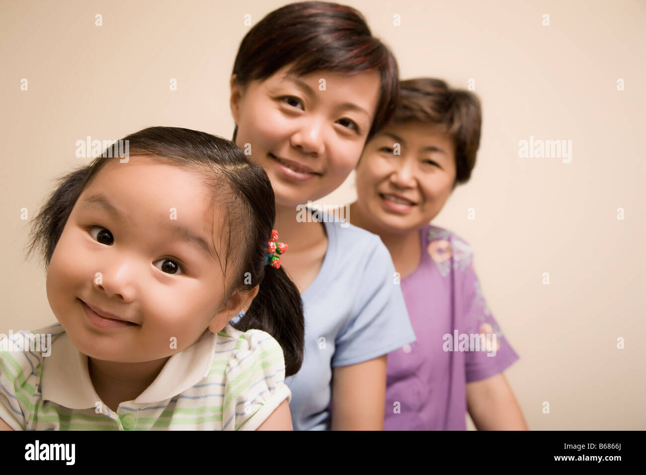 Portrait of a family in a row - Stock Image