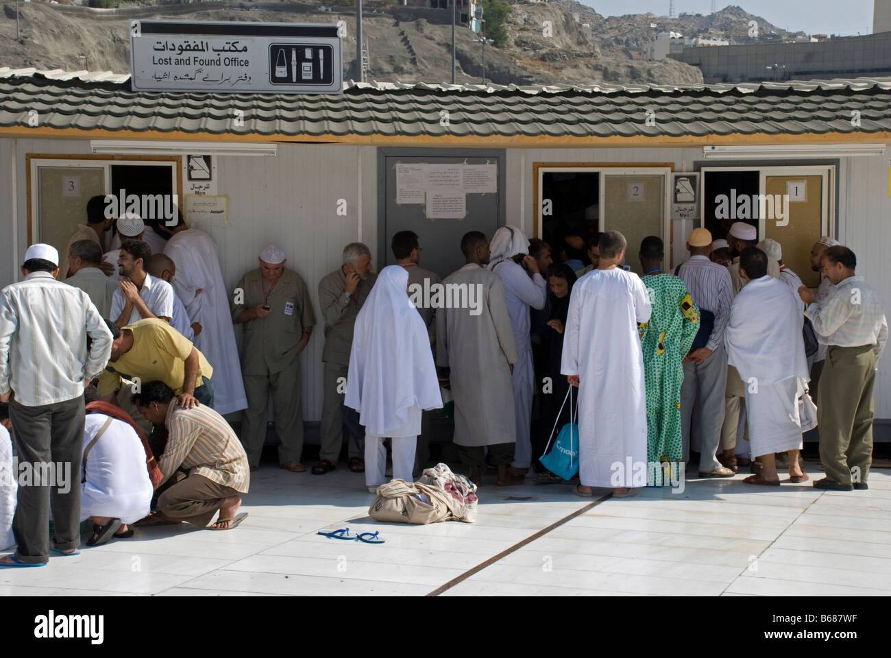 Pilgrims lining up near Masjid al Haram trying to access the