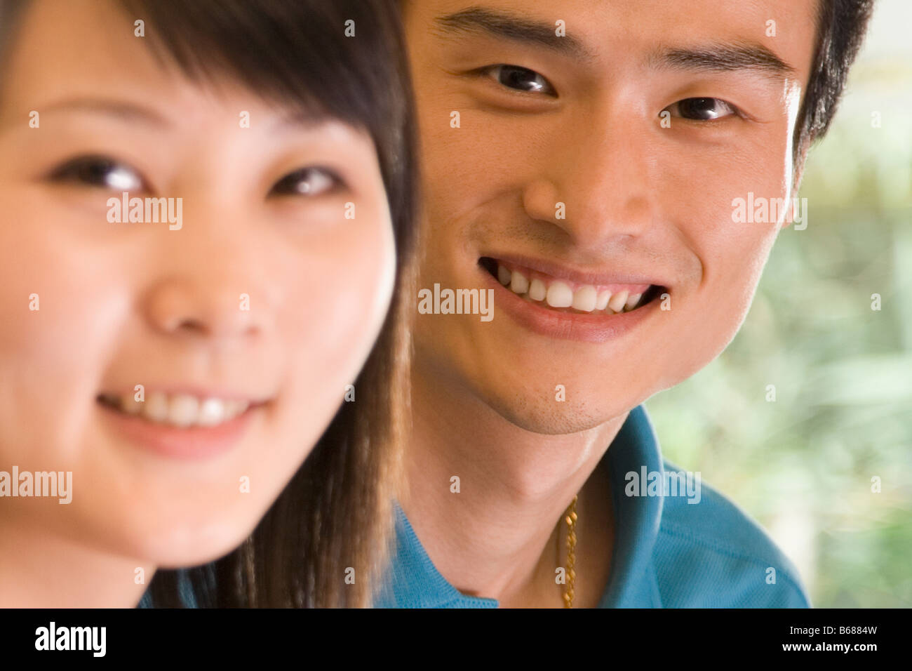 Portrait of two office workers smiling - Stock Image